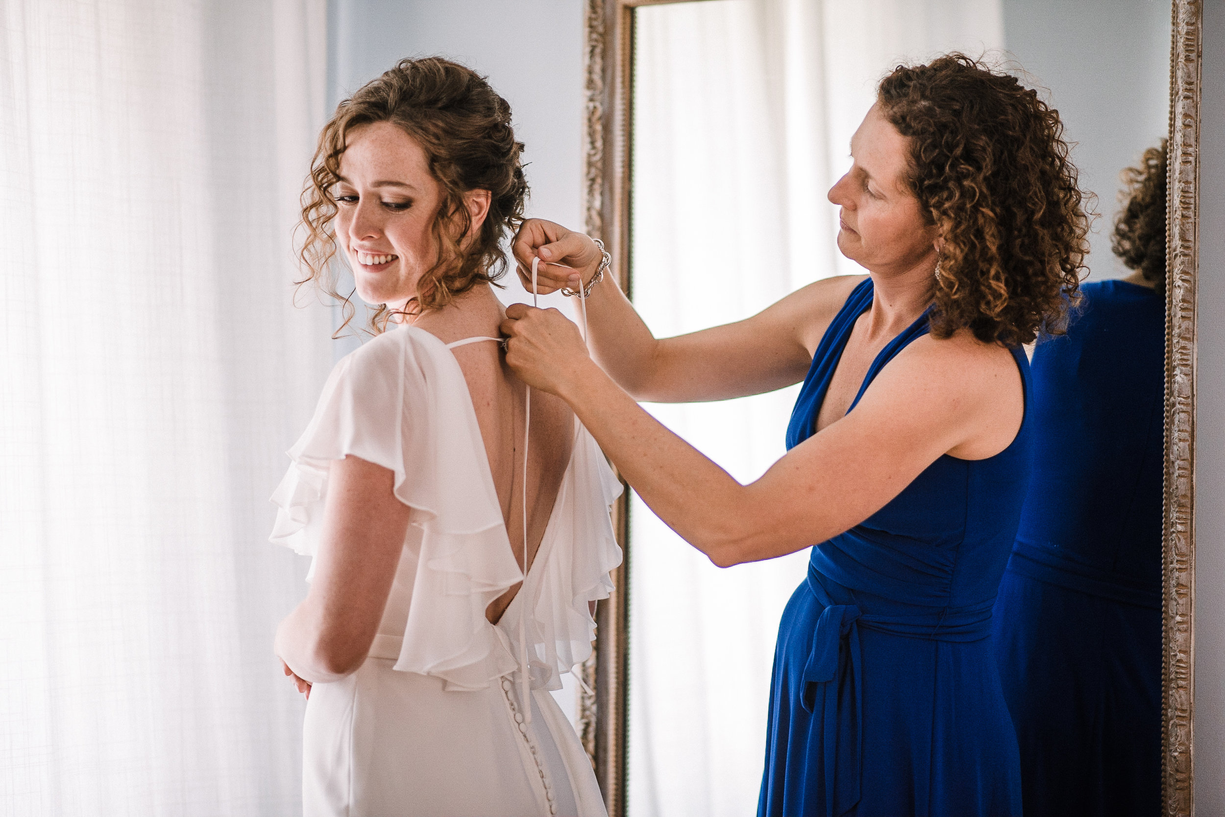 bride getting into wedding dress at tranquility farm