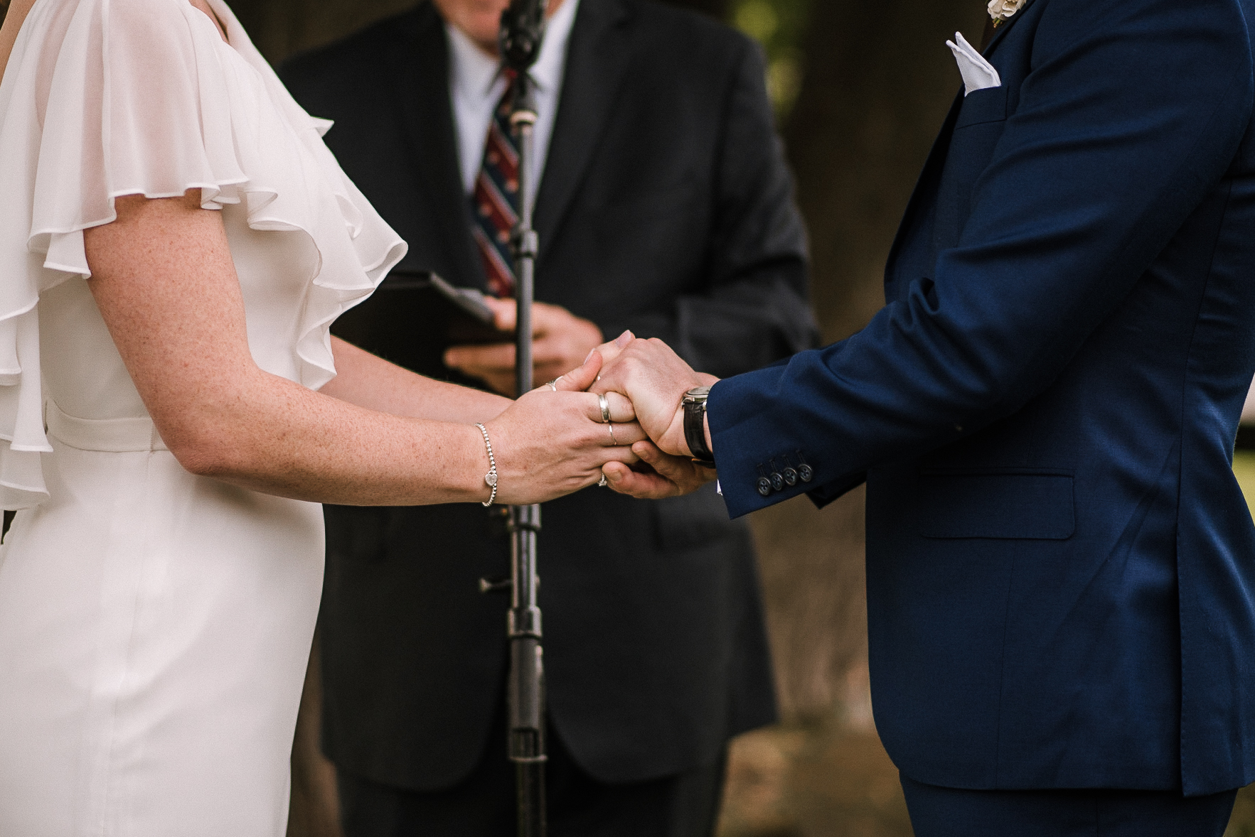bride and groom holding hands at tranquility farm