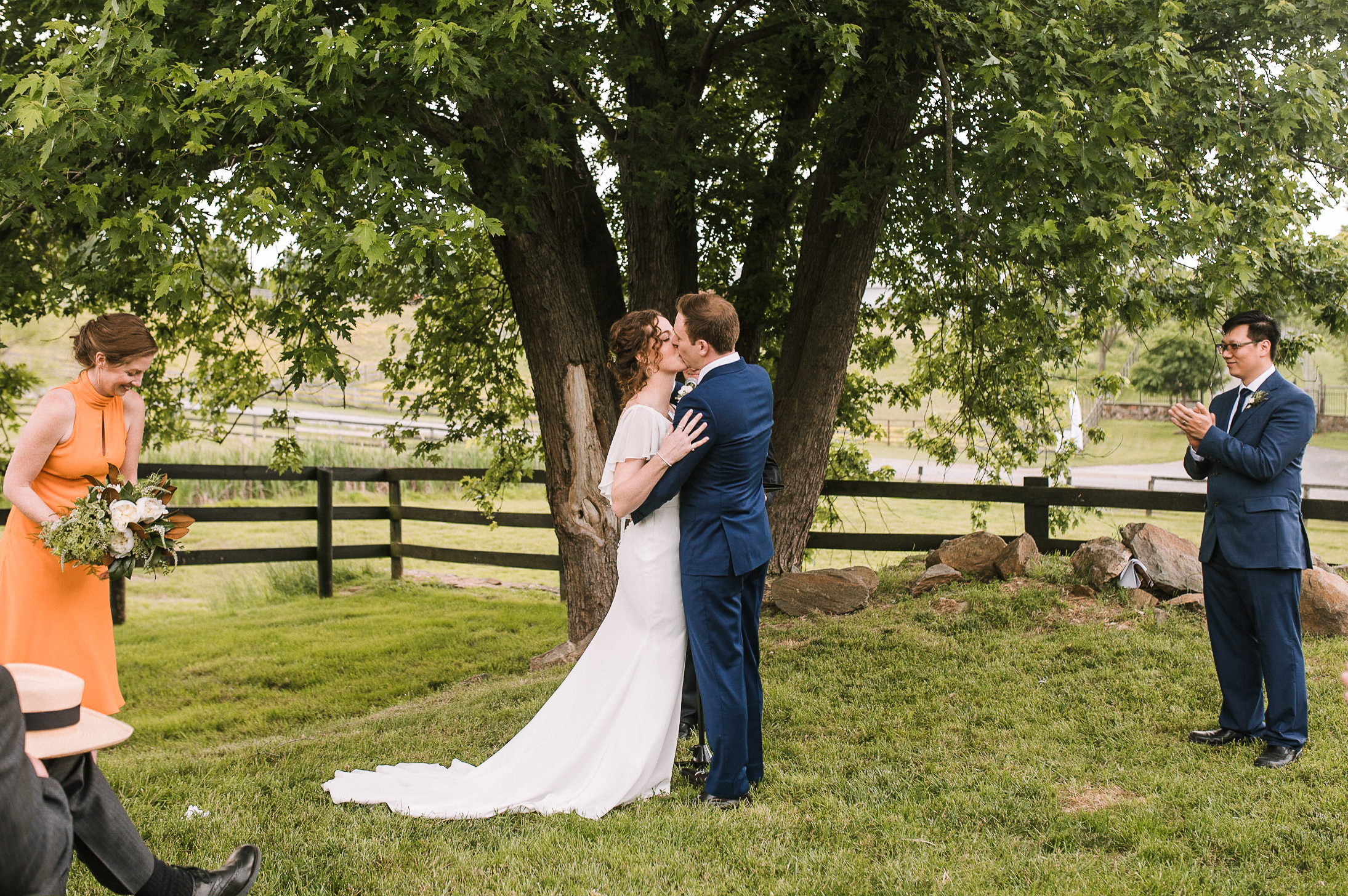bride and groom kissing after exchanging vows at tranquility farm