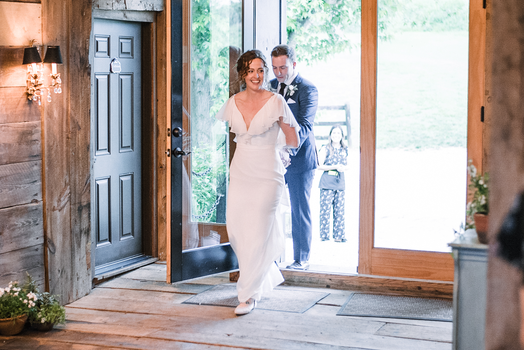bride and groom entering reception at tranquility farm