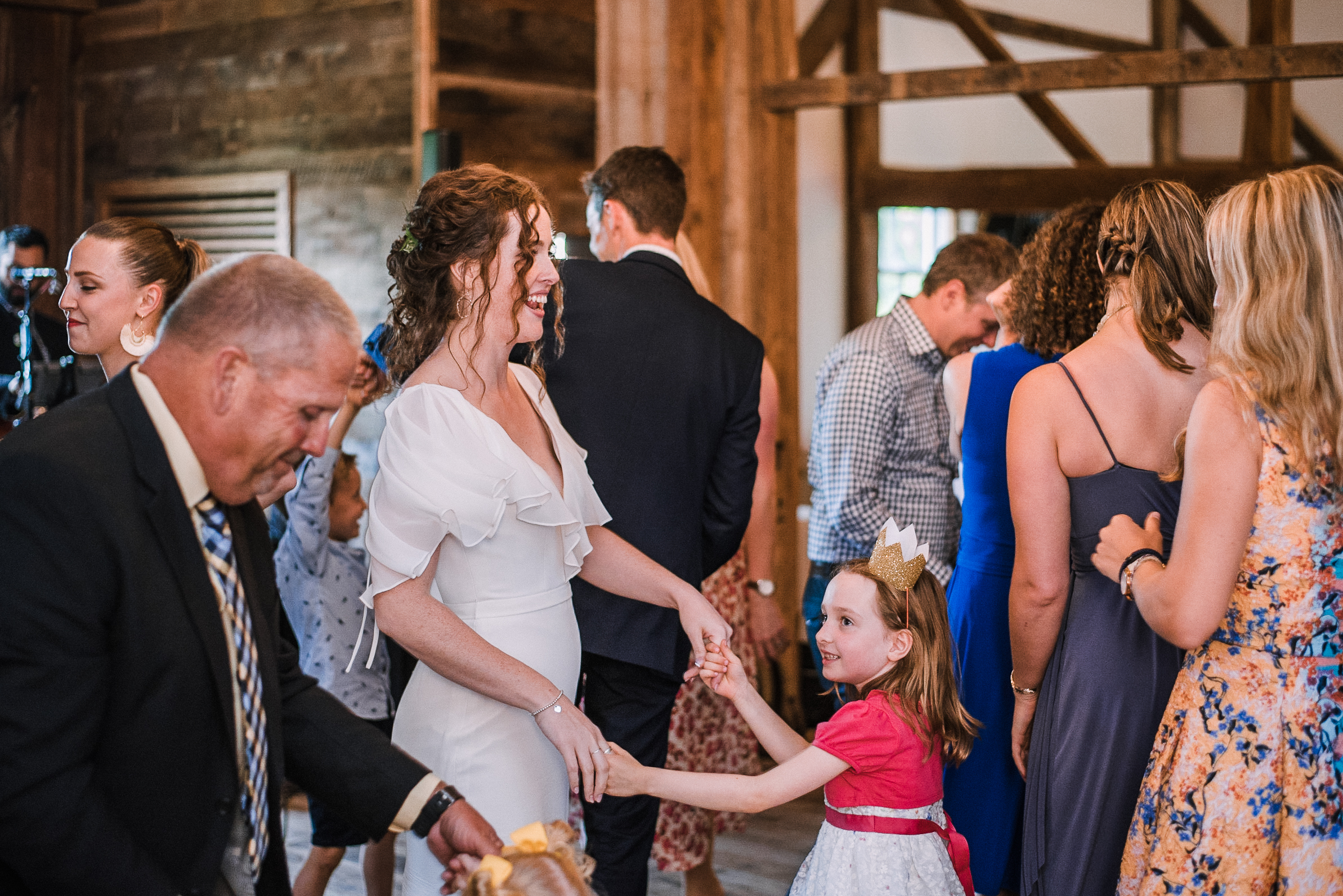 bride dancing with flower girl at tranquility farm