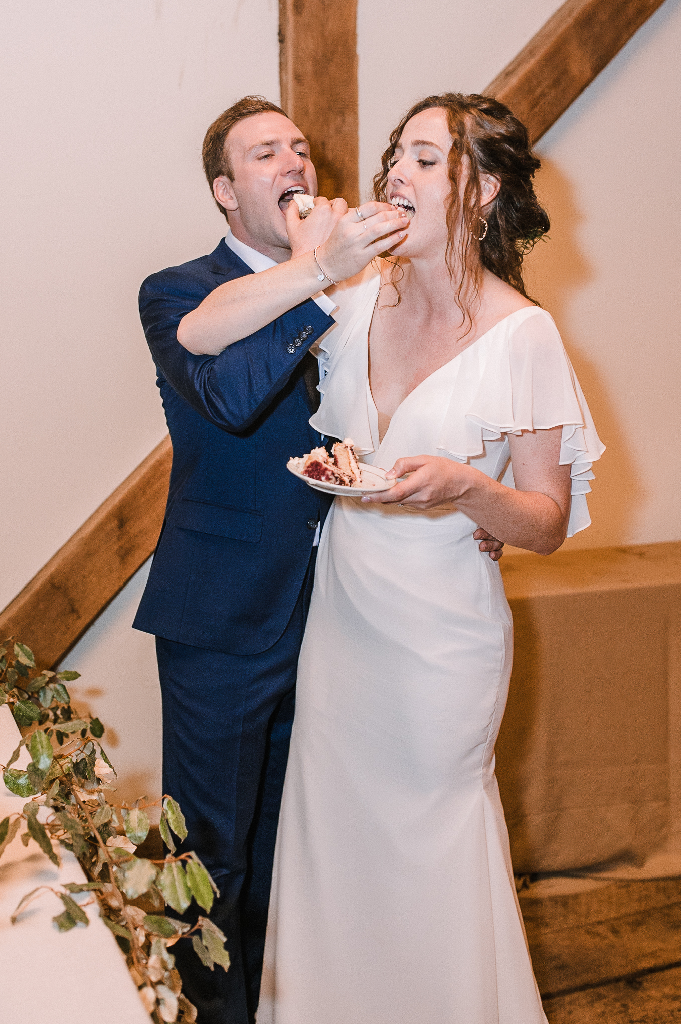 bride and groom eating cake at tranquility farm