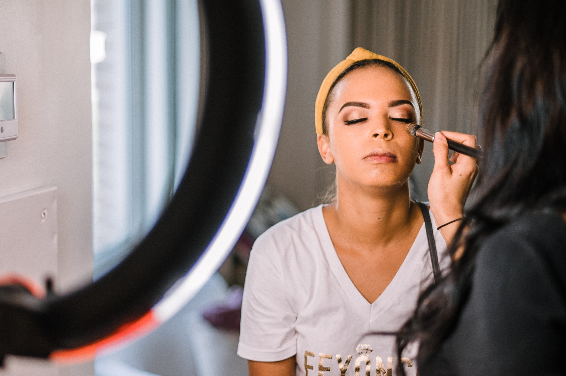 Bride getting her makeup done at The Park Hyatt Hotel in Washington DC