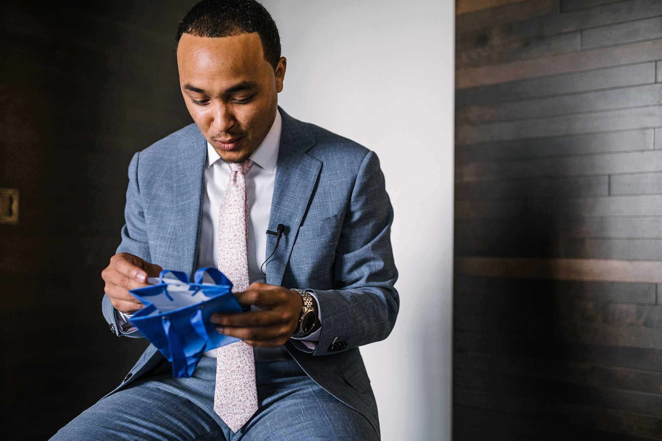 groom opening gift from bride at The Park Hyatt Hotel in Washington DC
