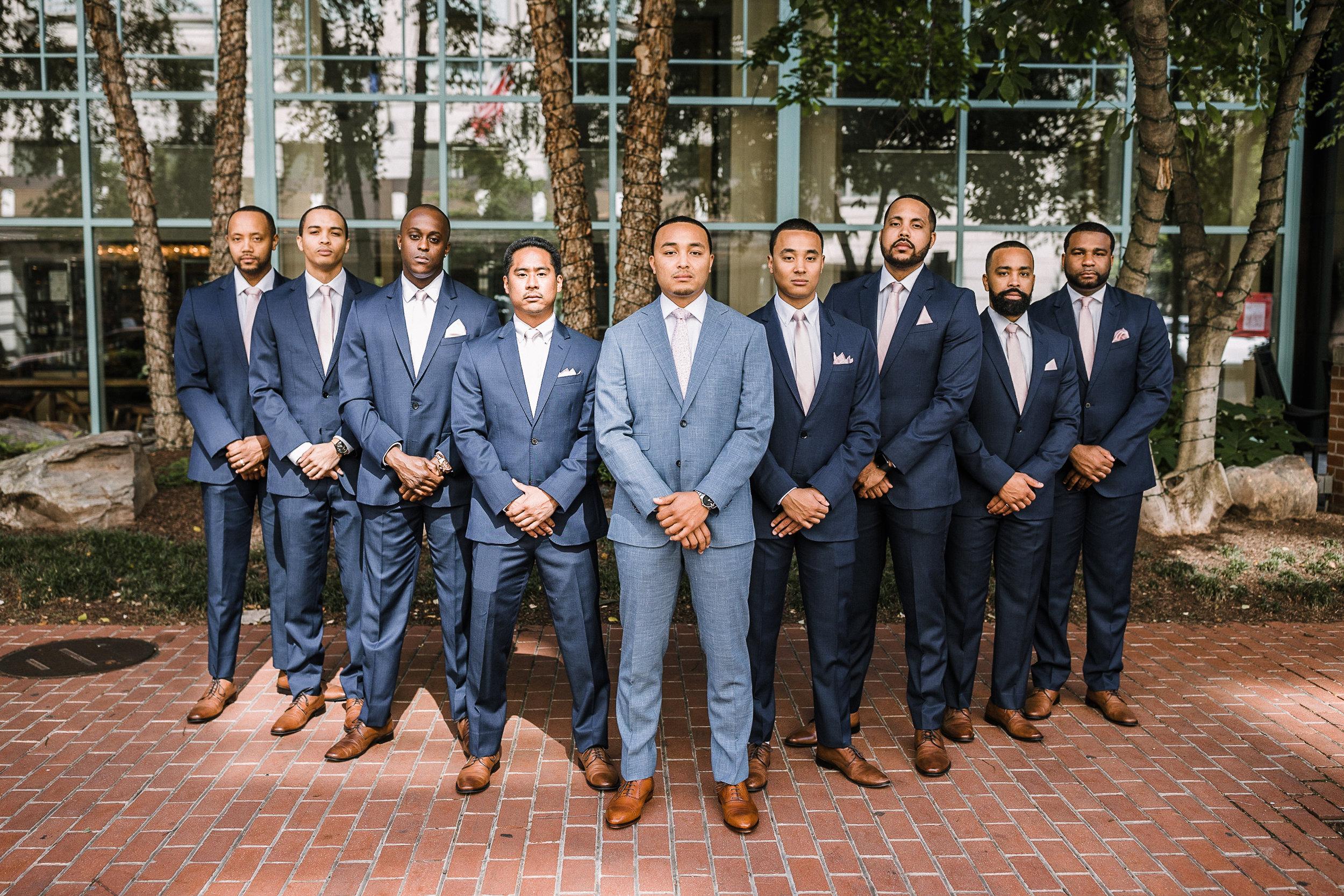groom and groomsmen posing at The Park Hyatt Hotel in Washington DC