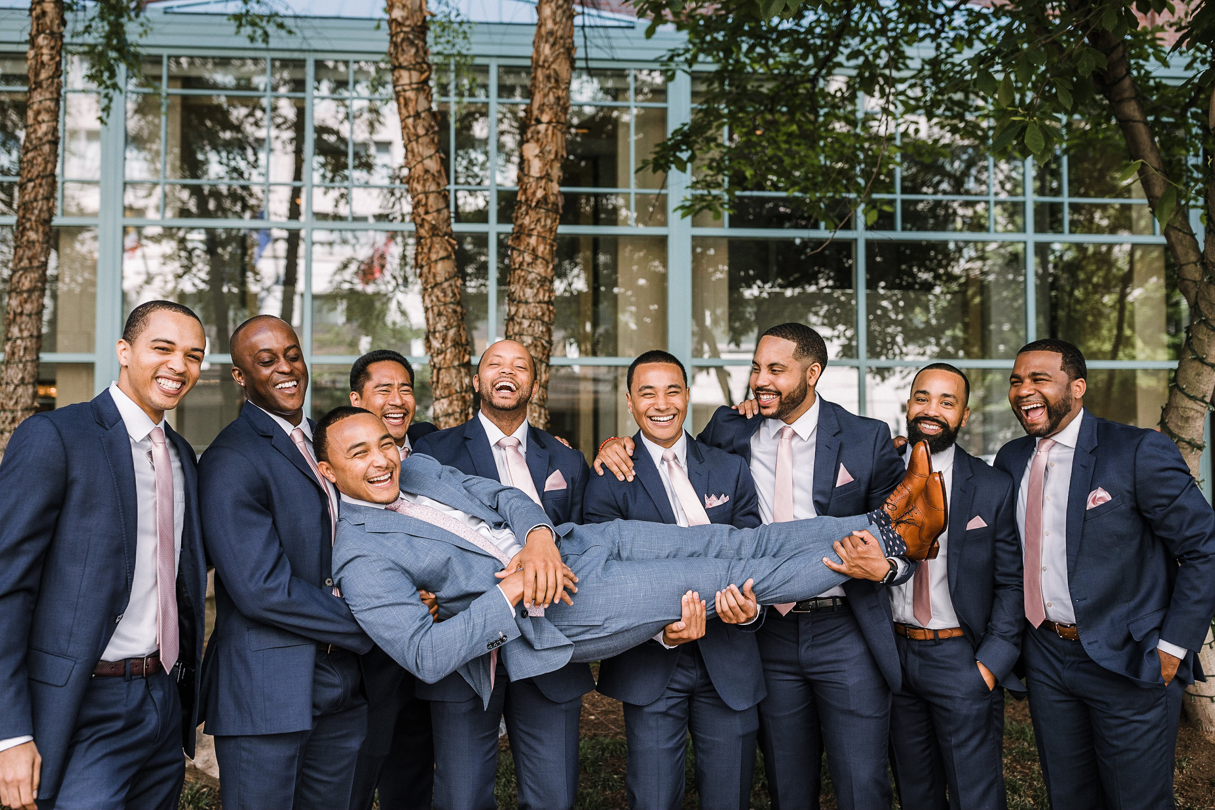 groom being carried by groomsmen at The Park Hyatt Hotel in Washington DC