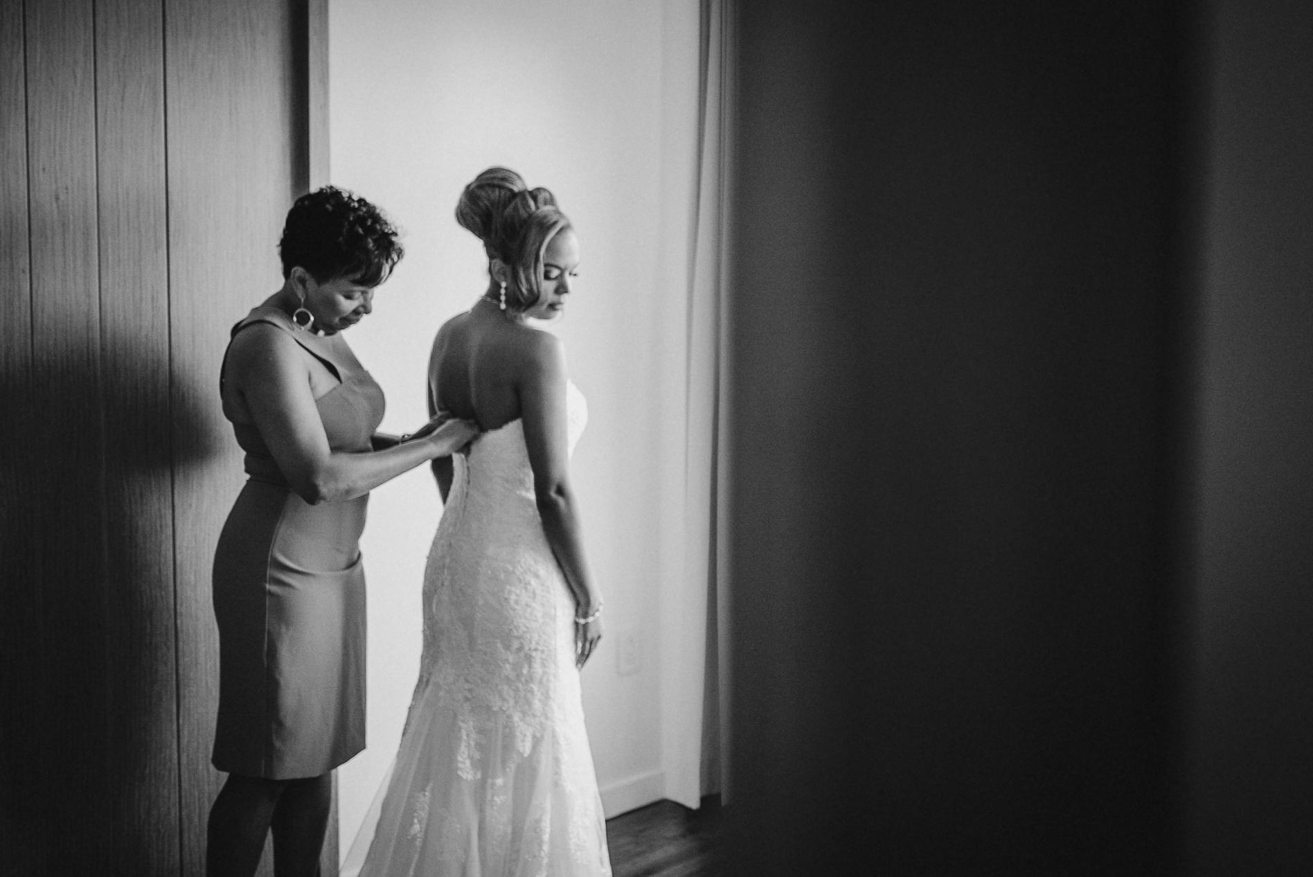 bride getting into wedding dress at The Park Hyatt Hotel in Washington DC