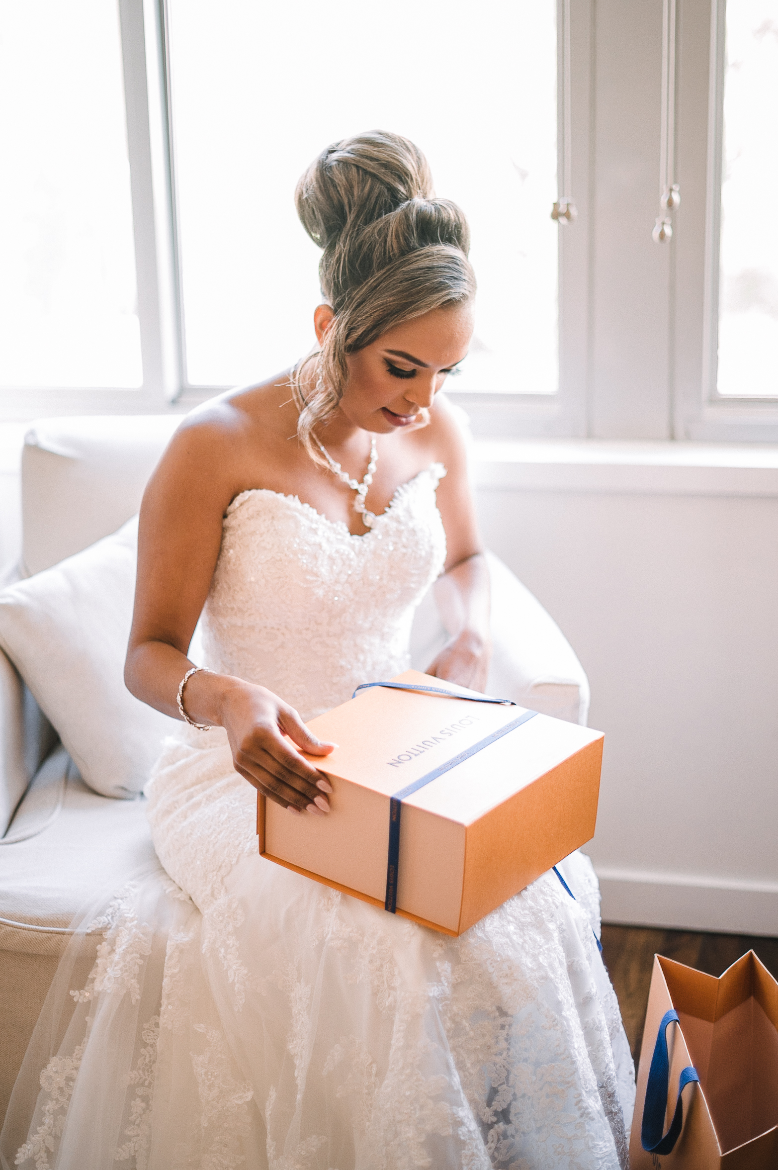 bride opening gift from groom at The Park Hyatt Hotel in Washington DC