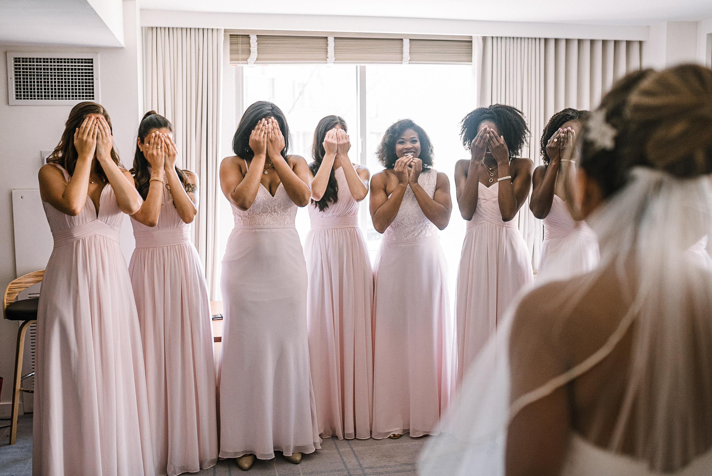 bride doing a first look with bridesmaids at The Park Hyatt Hotel in Washington DC