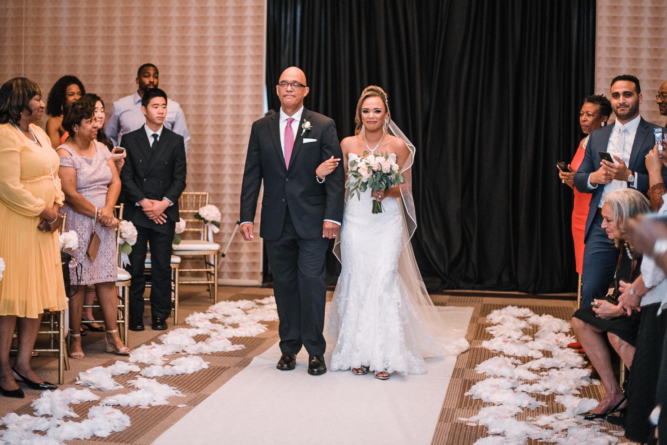 bride walking down the aisle at The Park Hyatt Hotel in Washington DC