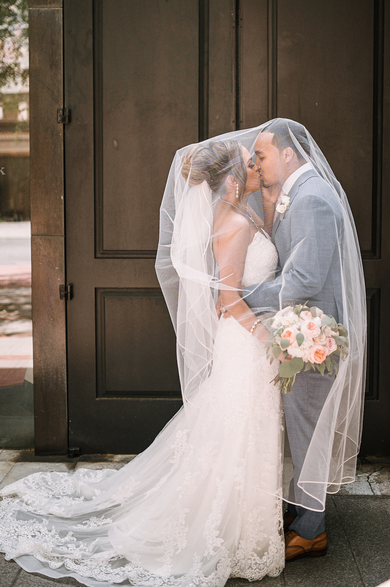 bride and groom kissing under veil at The Park Hyatt Hotel in Washington DC