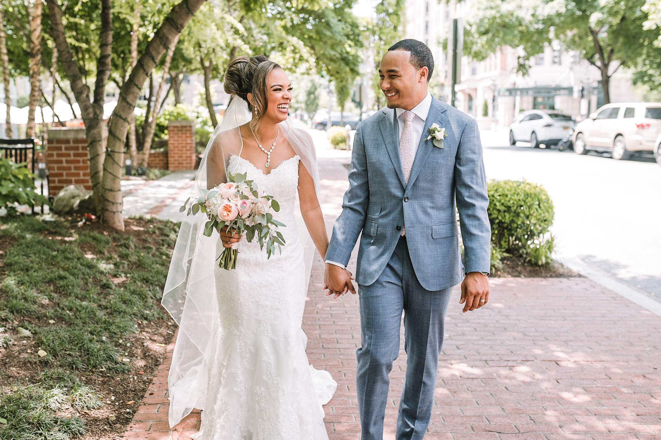 bride and groom holding hands and walking at The Park Hyatt Hotel in Washington DC