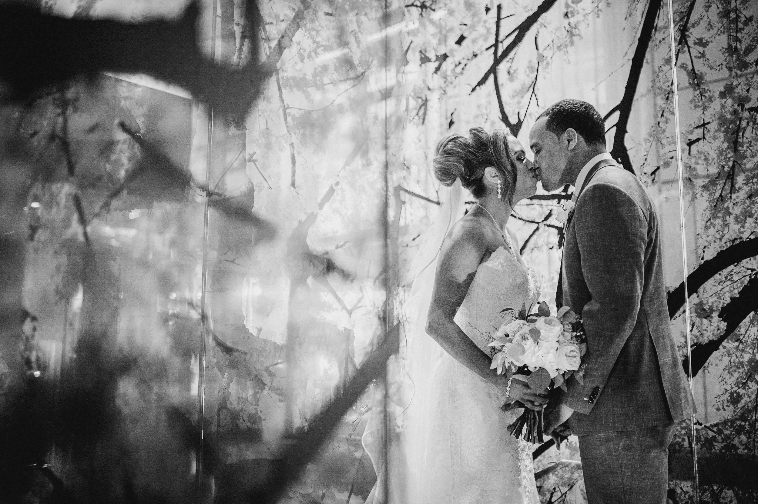 bride and groom kissing at The Park Hyatt Hotel in Washington DC