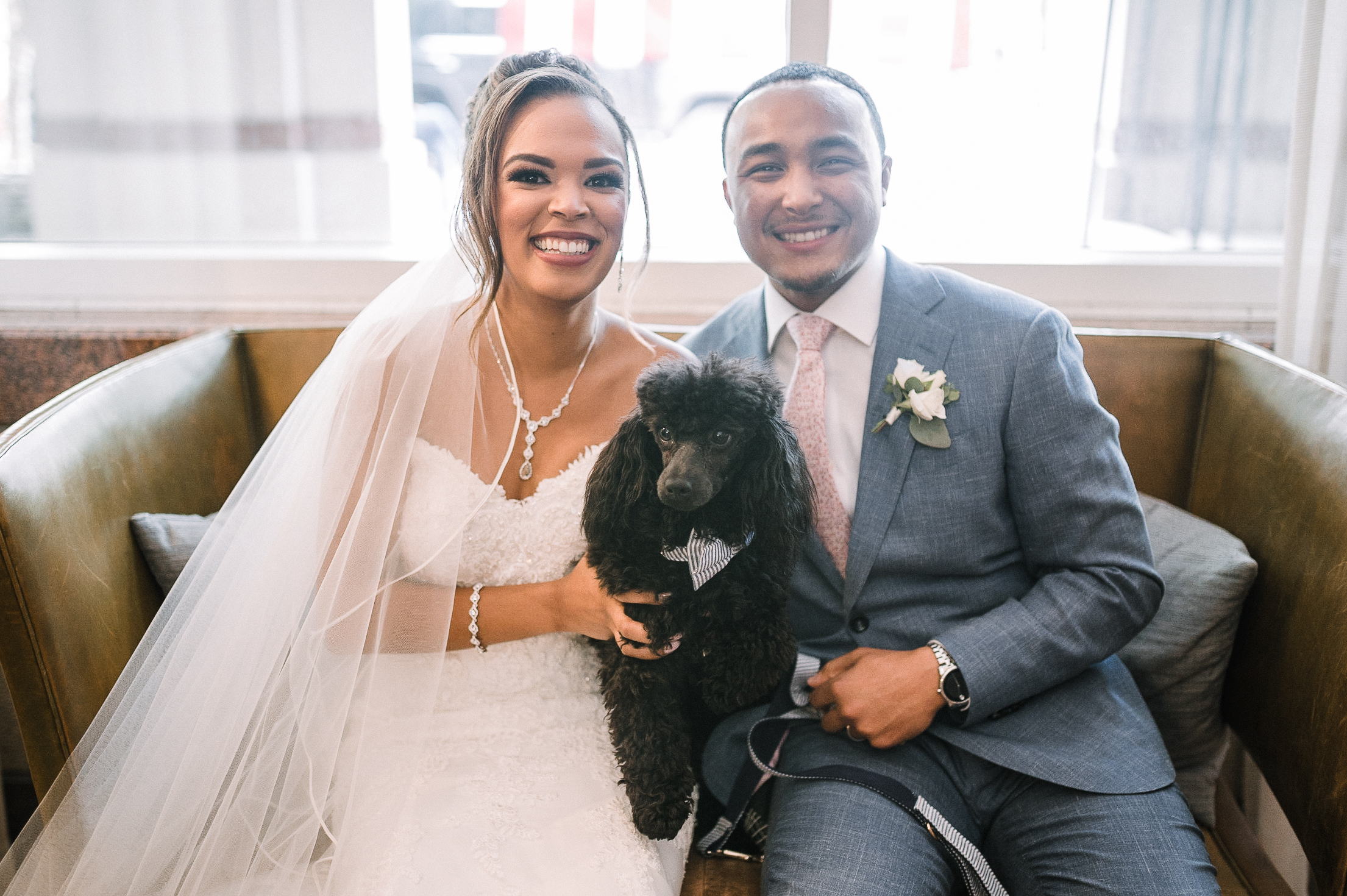 bride and groom smiling with their dog at The Park Hyatt Hotel in Washington DC