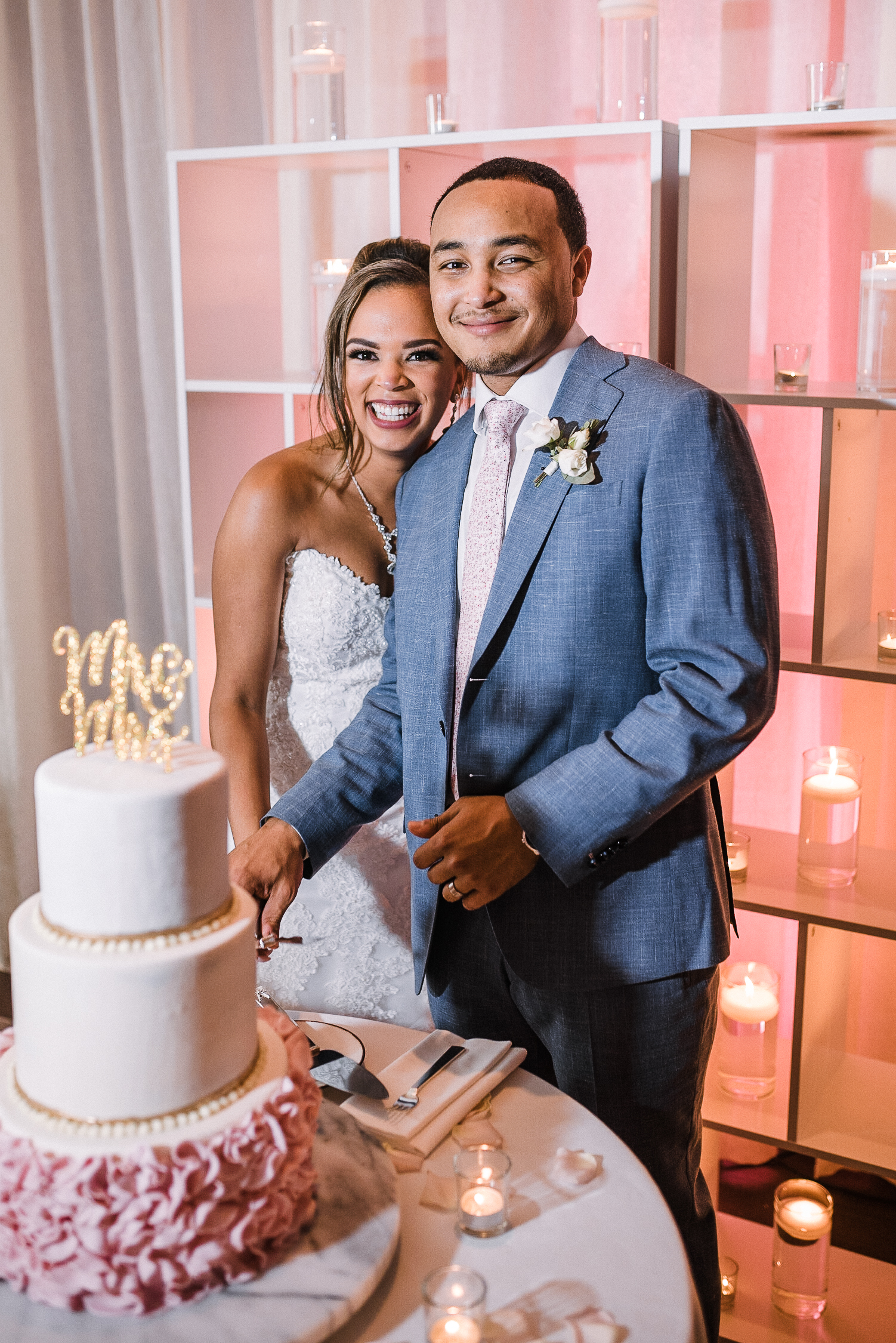 bride and groom smiling as they cut the cake at The Park Hyatt Hotel in Washington DC