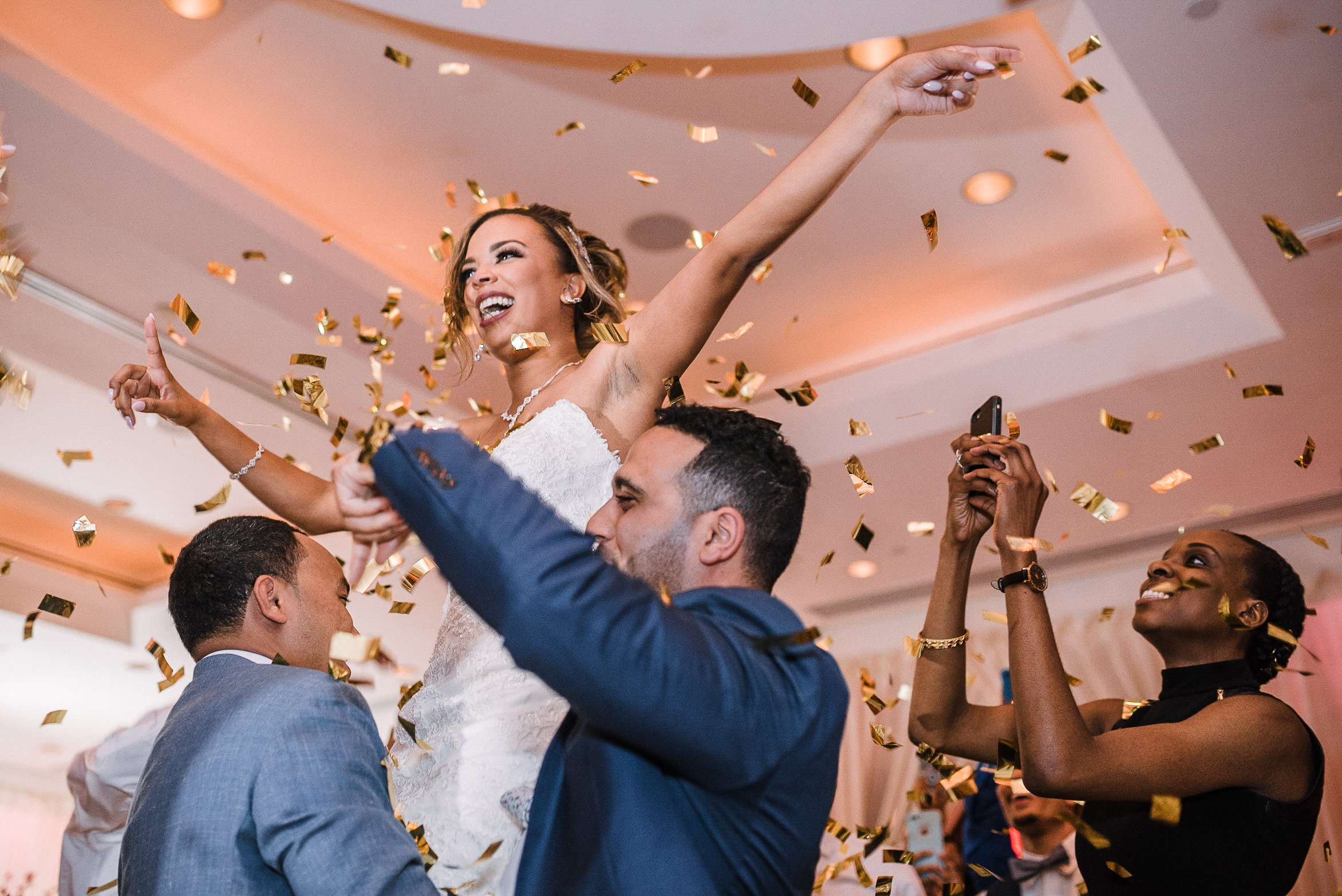 bride being lifted into the air at The Park Hyatt Hotel in Washington DC