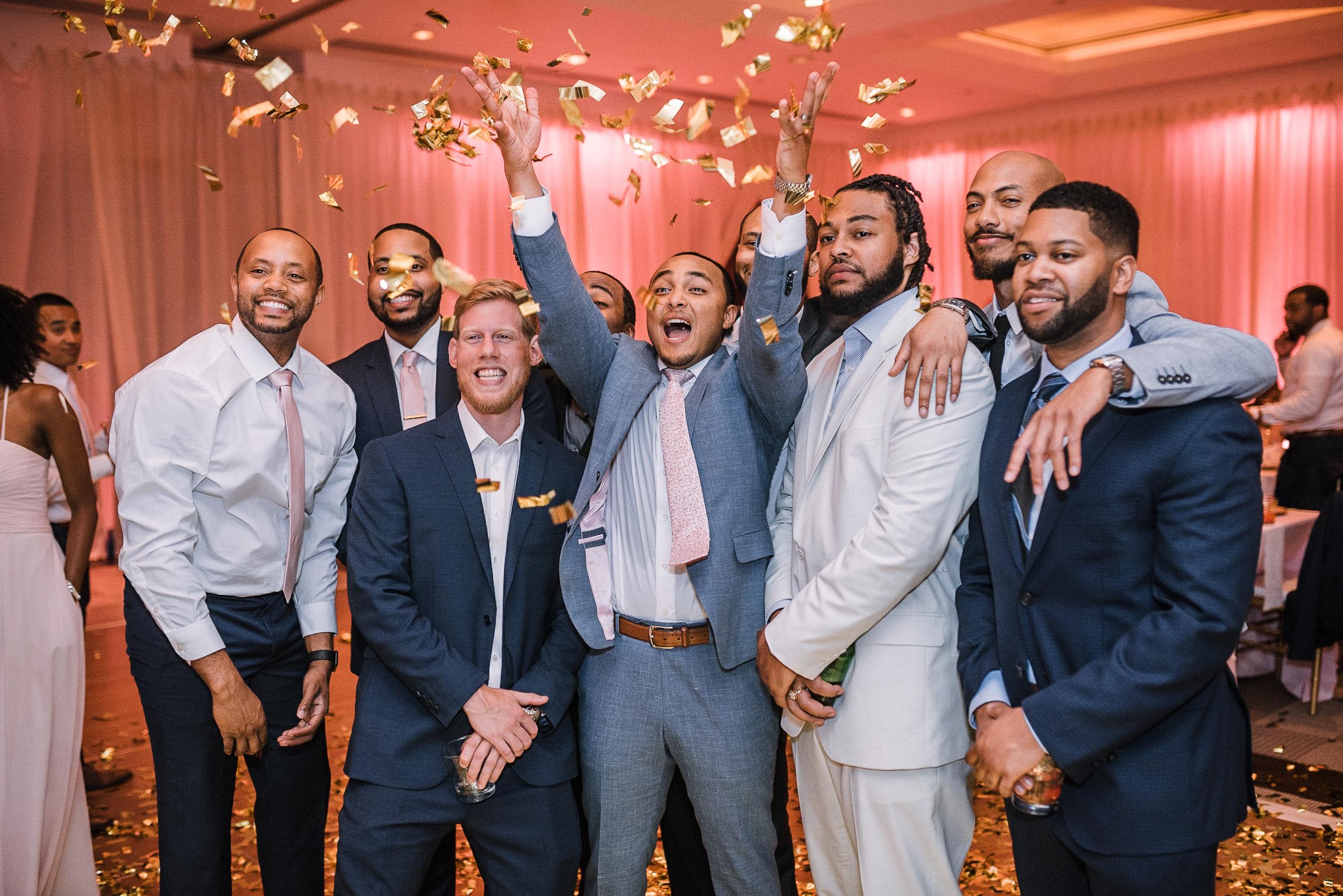 groom throwing confetti at The Park Hyatt Hotel in Washington DC