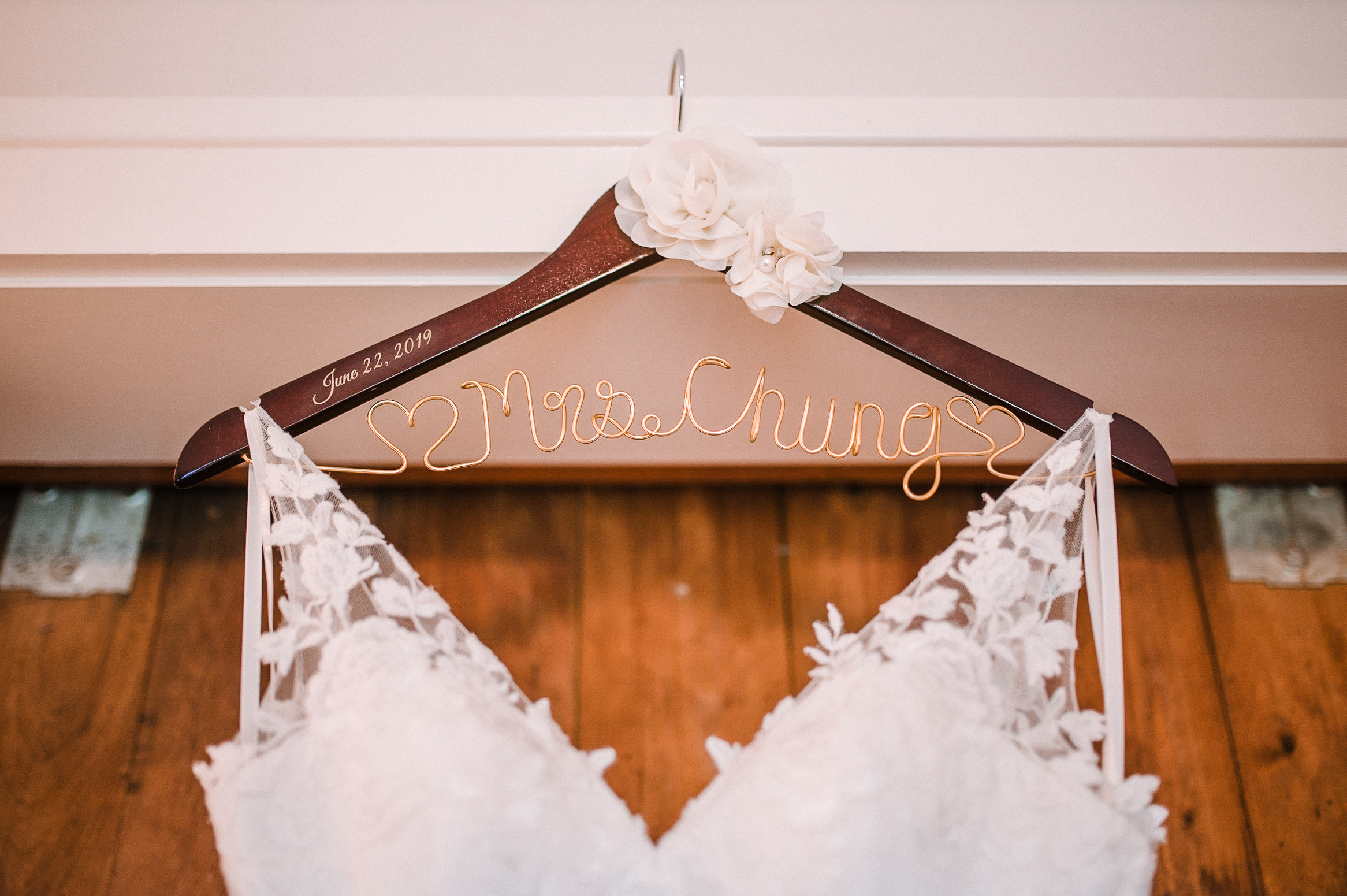 detail shot of wedding dress and hanger at Bluemont Vineyard