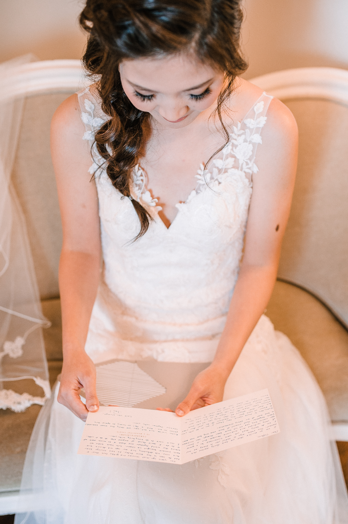 bride reading letter from groom at Bluemont Vineyard