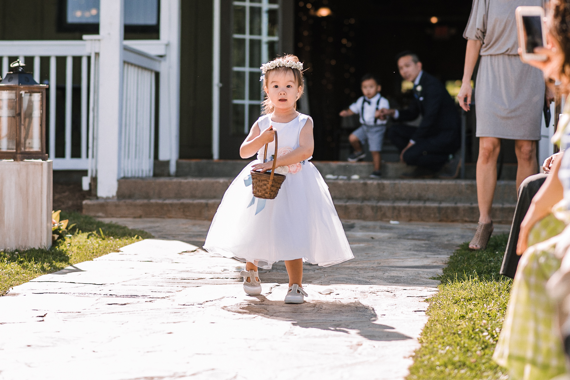 flower girl coming down the aisle at Bluemont Vineyard