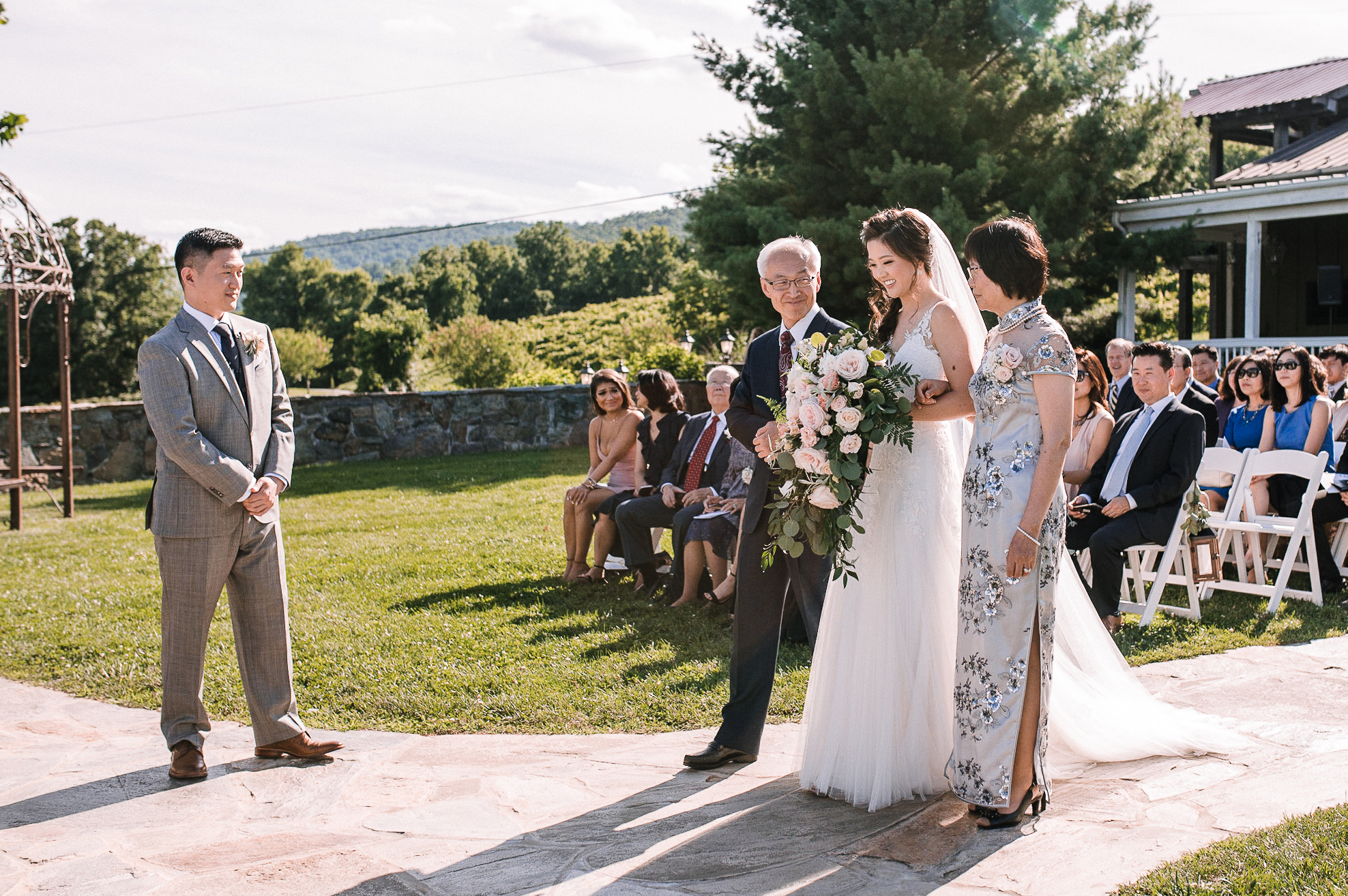 bride coming down the aisle at Bluemont Vineyard