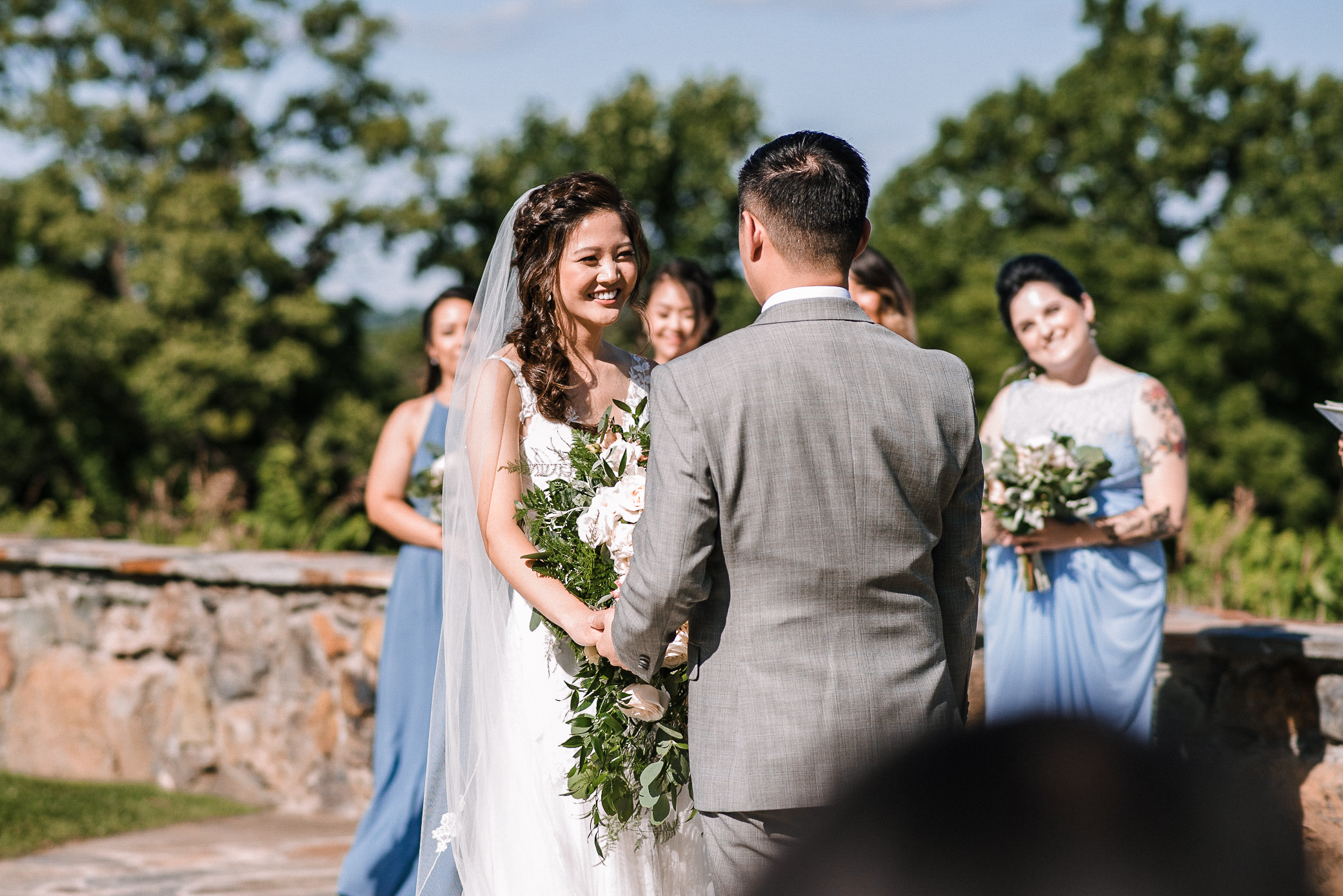 bride smiling at groom at the altar at Bluemont Vineyard
