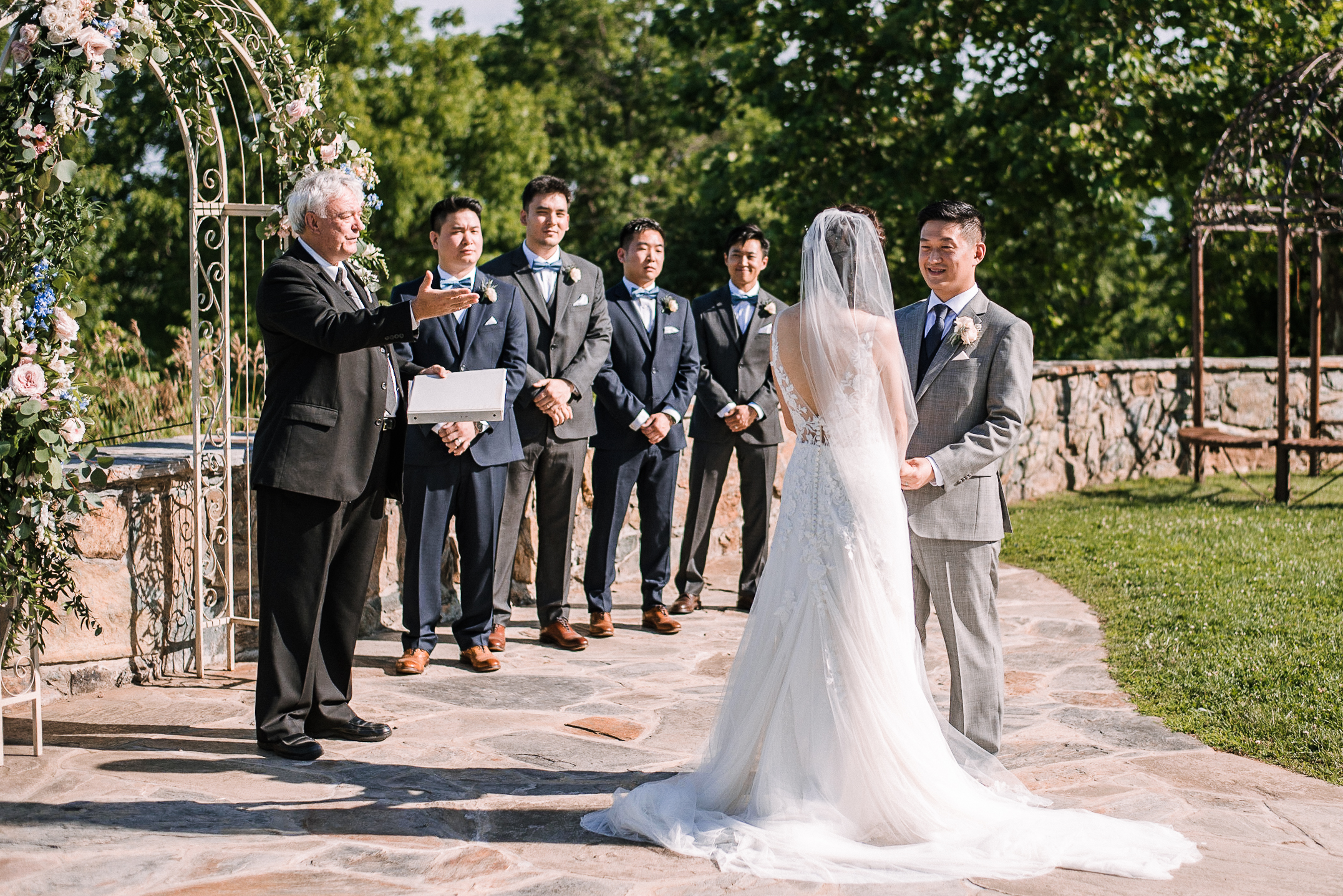 bride and groom holding hands at the altar at Bluemont Vineyard