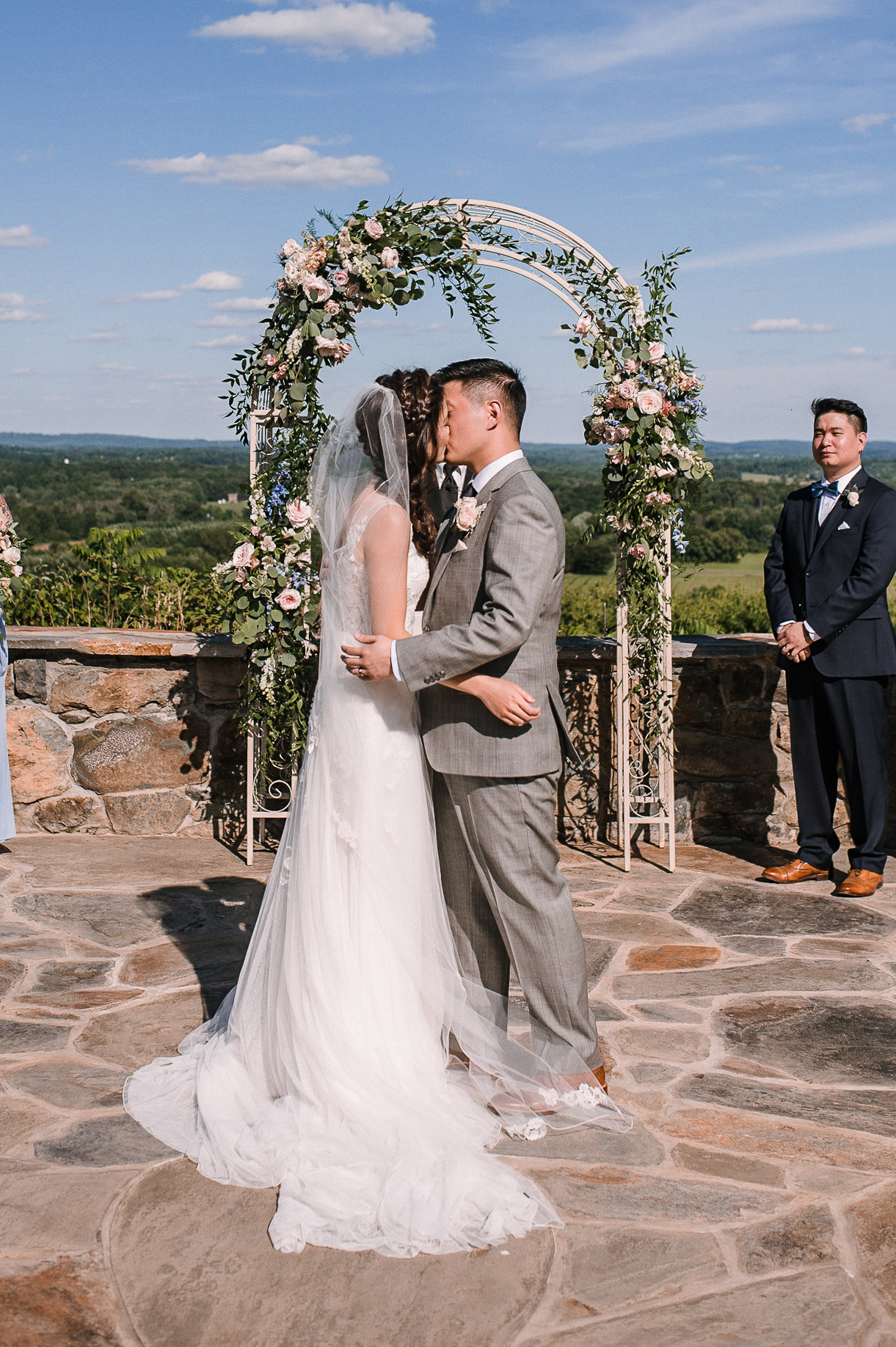 bride and groom kissing during wedding ceremony at Bluemont Vineyard