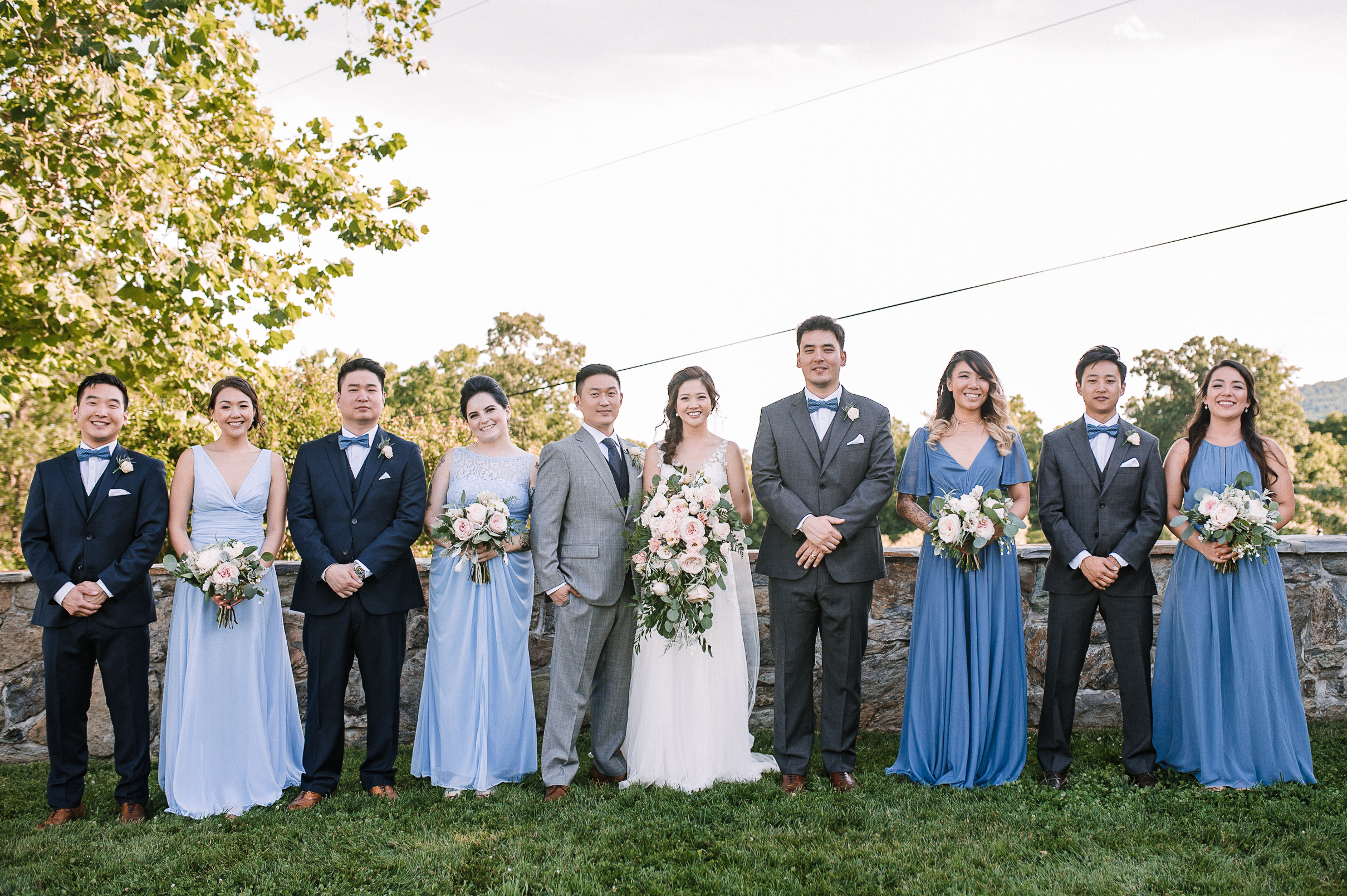 wedding party smiling at Bluemont Vineyard