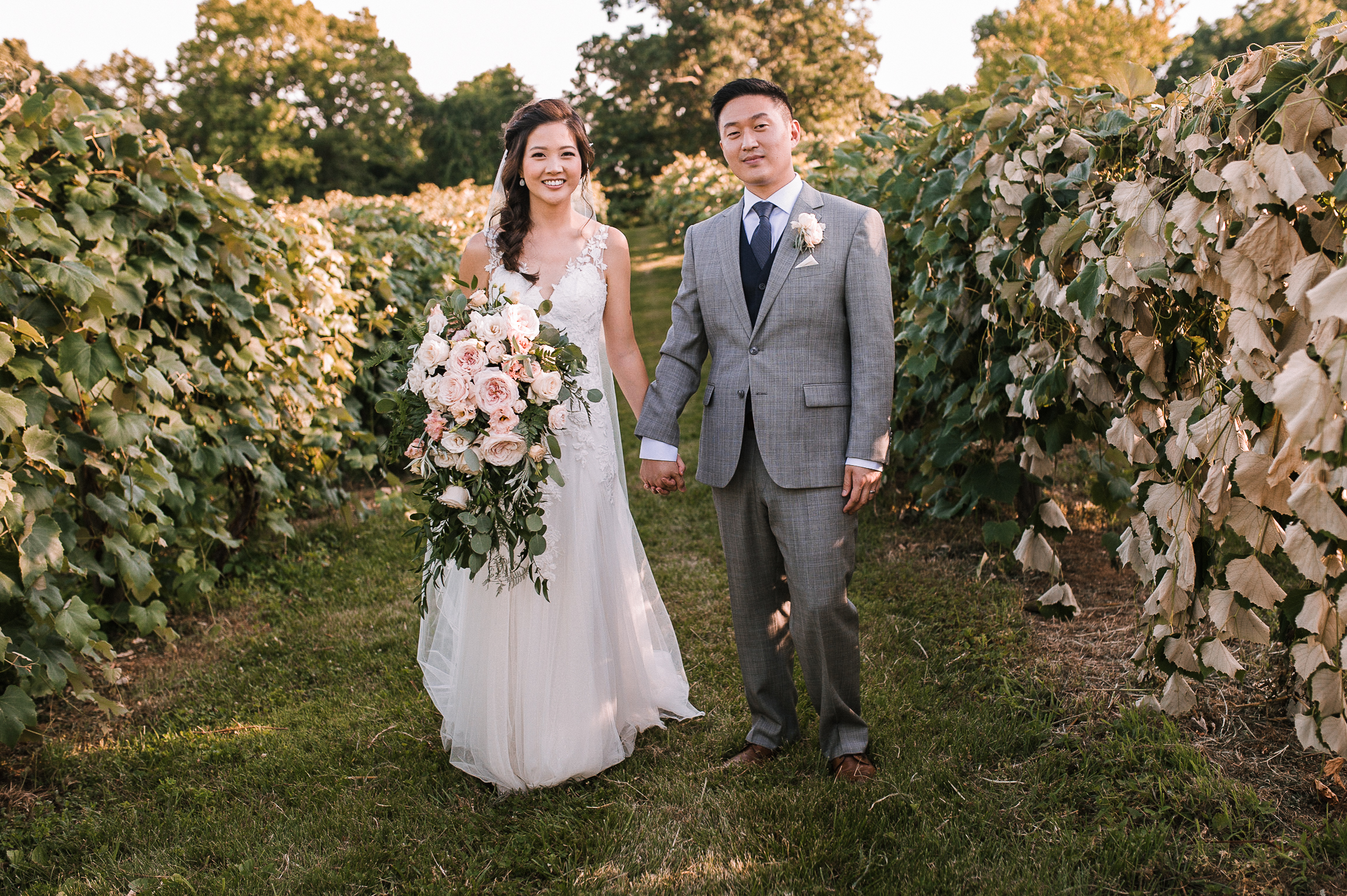 bride and groom smiling at Bluemont Vineyard