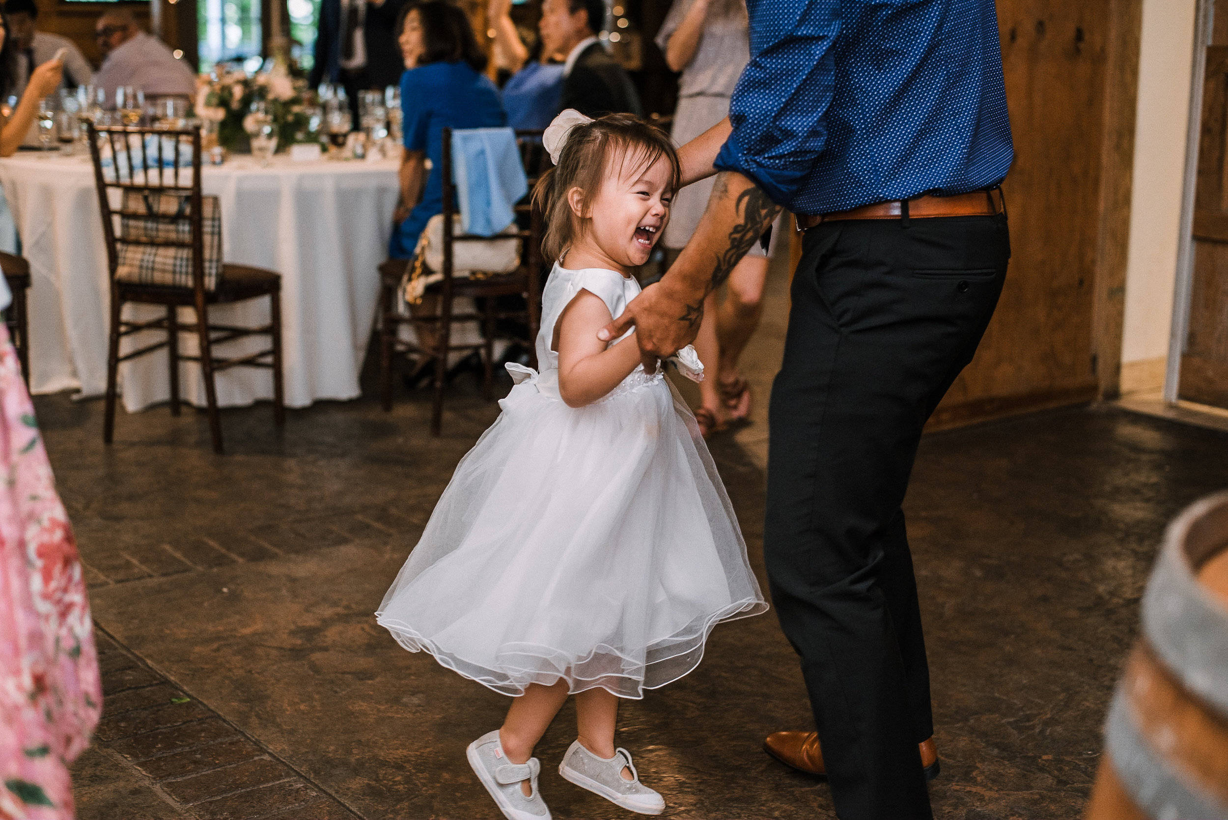 flower girl dancing at reception at Bluemont Vineyard