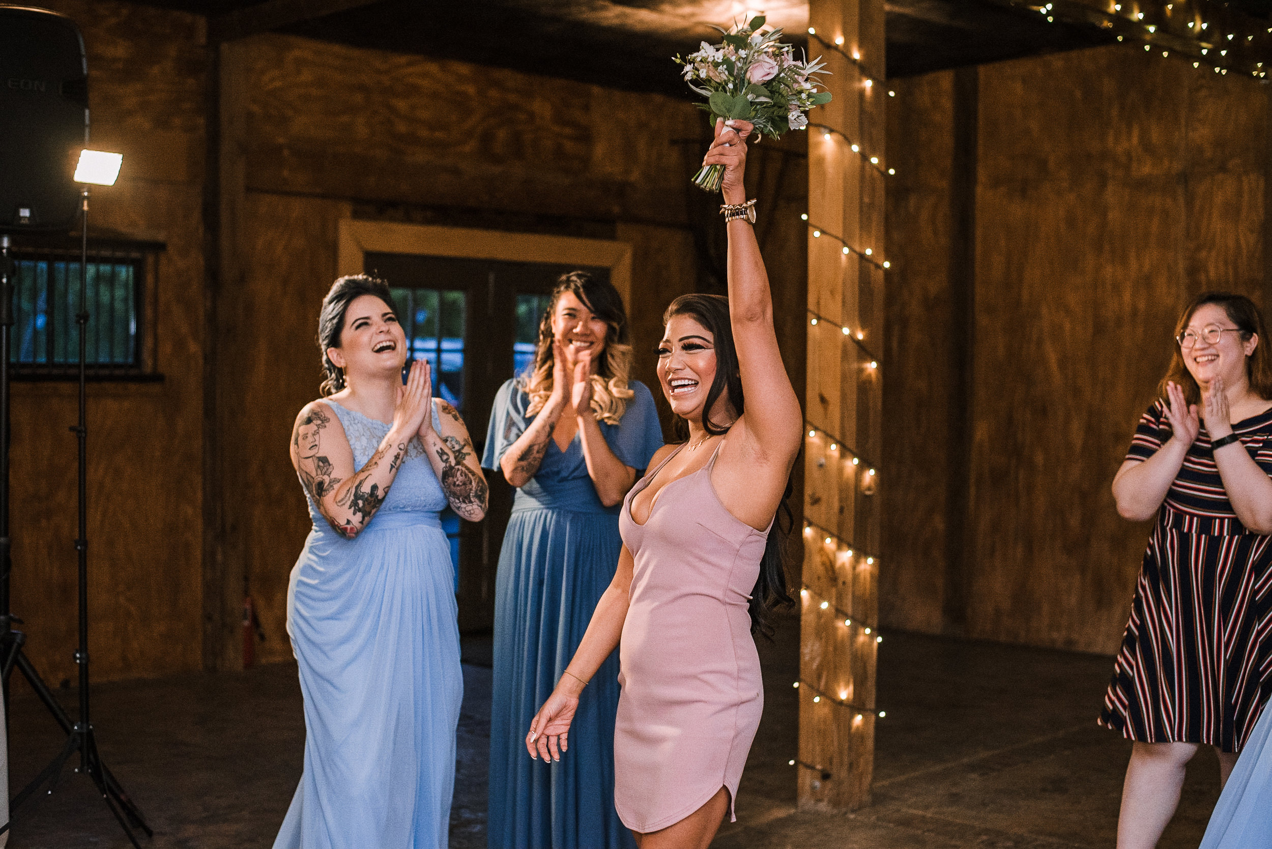 wedding guest catching bouquet at Bluemont Vineyard