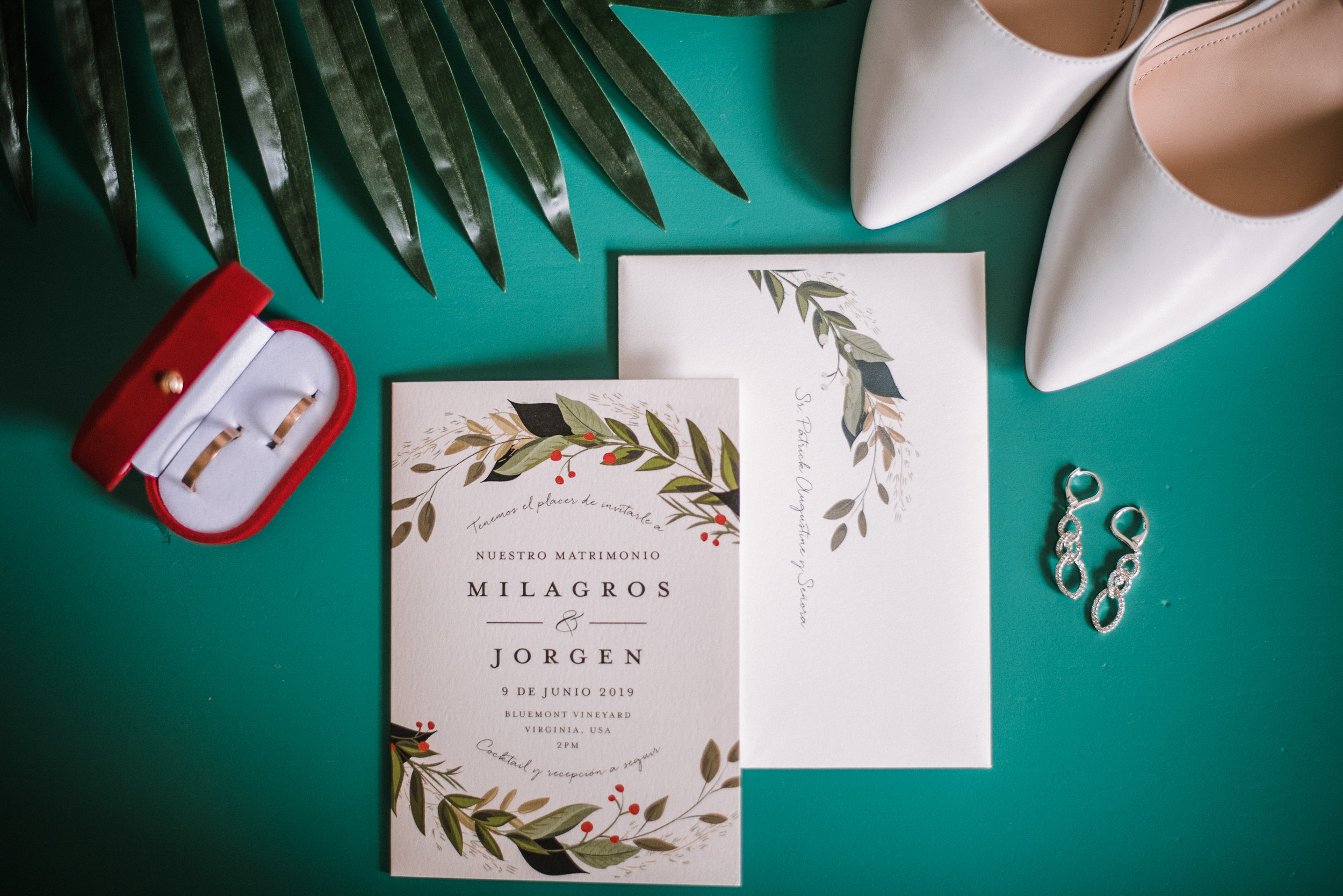 detail shot of wedding stationery and wedding rings and shoes at Bluemont Vineyard