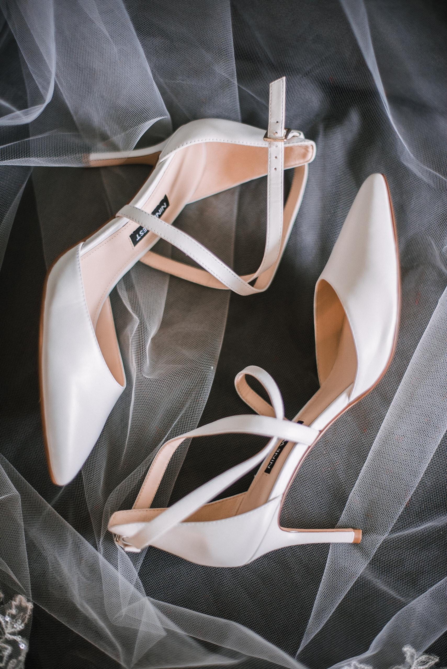 detail shot of bride's wedding shoes at Bluemont Vineyard