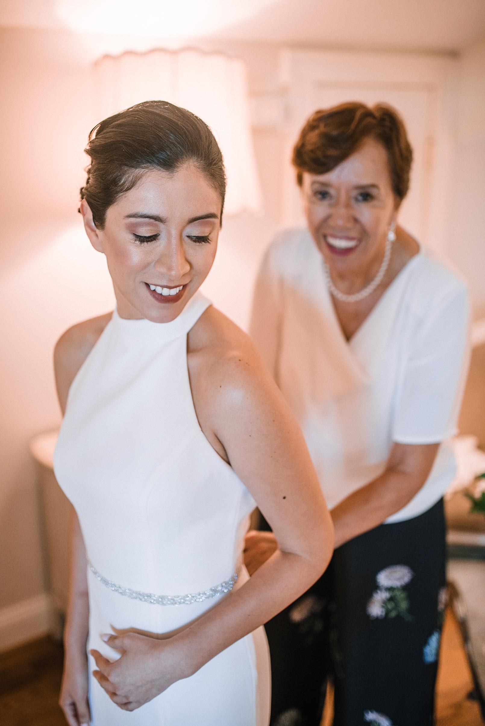bride getting into wedding dress at Bluemont Vineyard