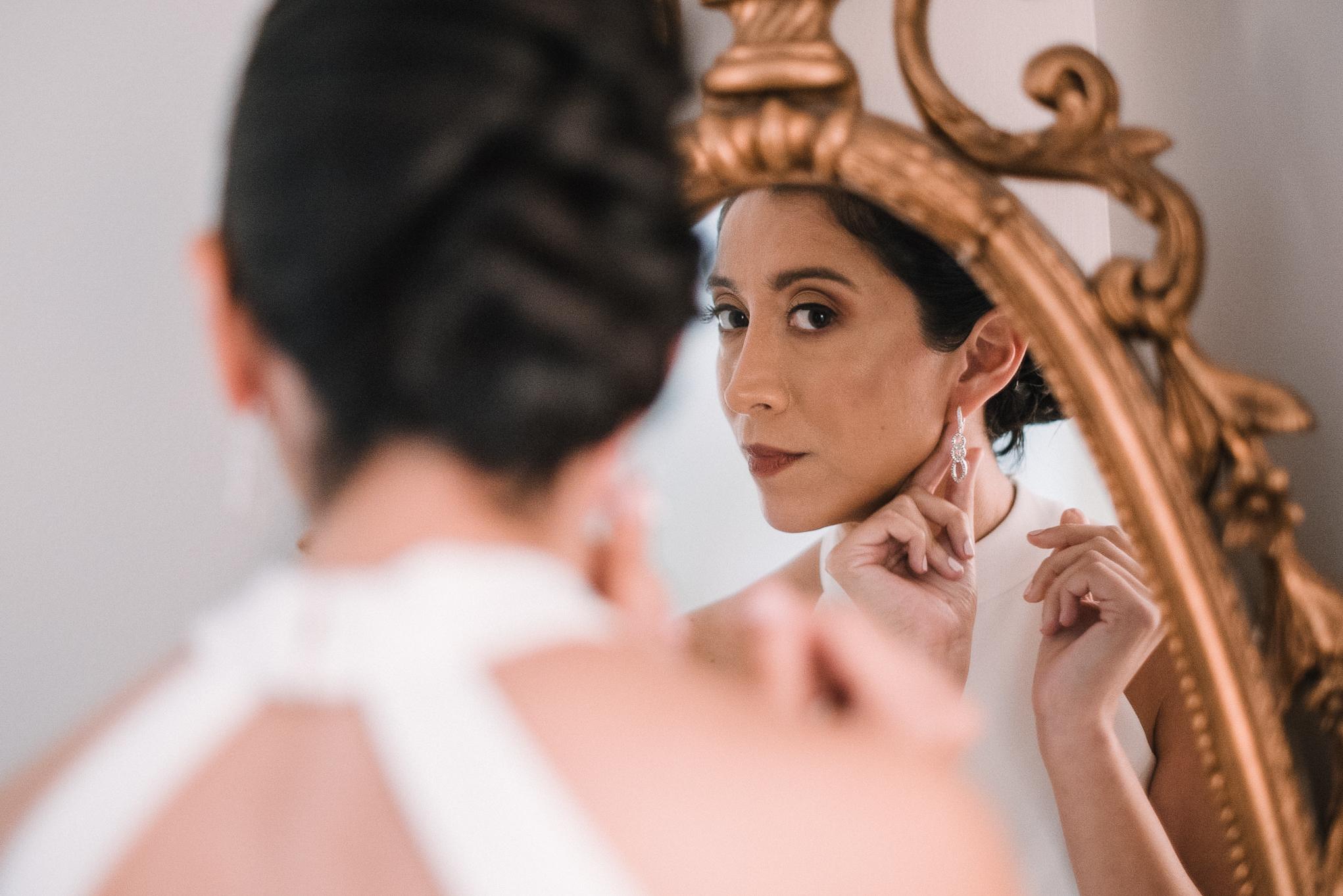bride putting on earrings at Bluemont Vineyard