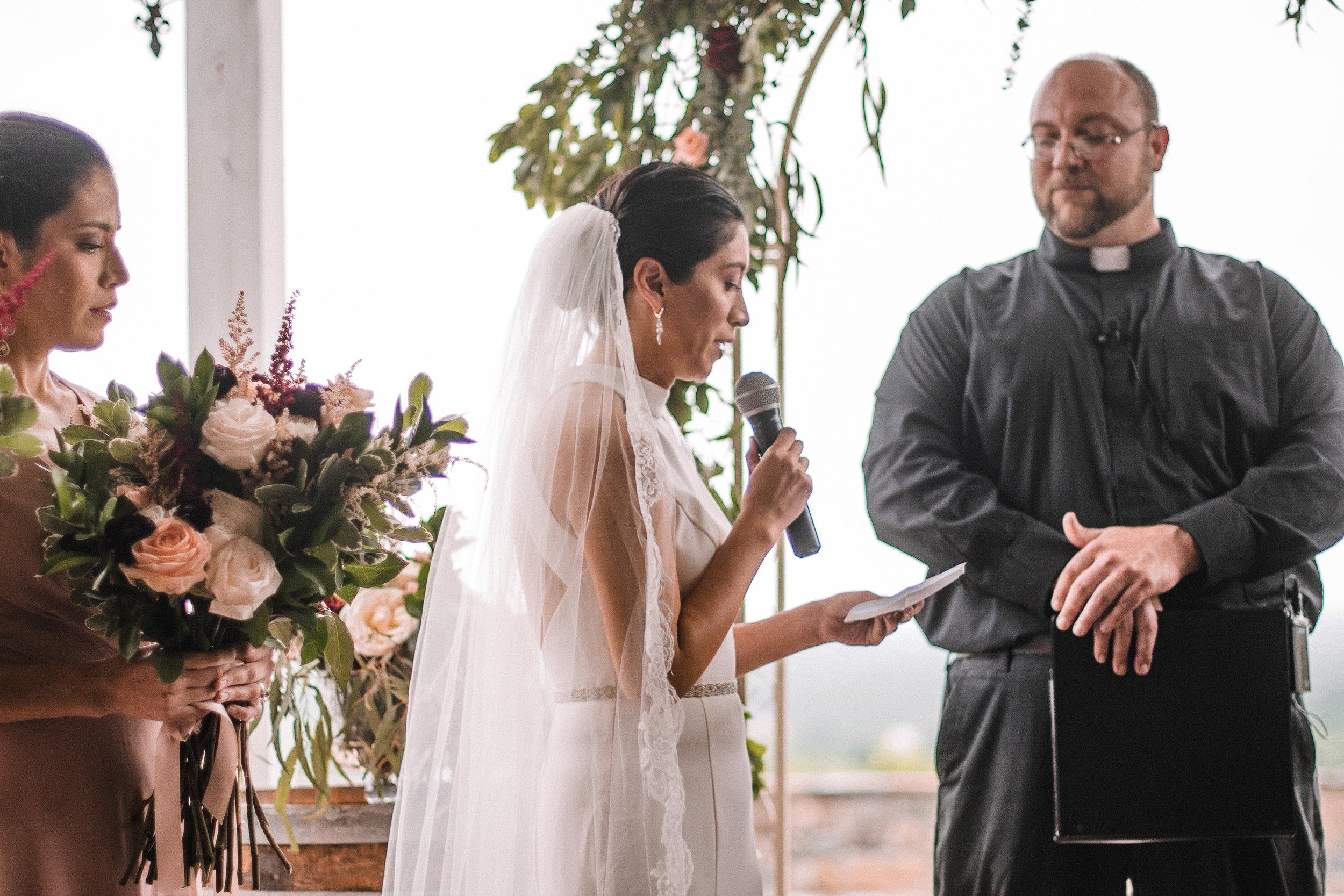 bride reading her vows at Bluemont Vineyard