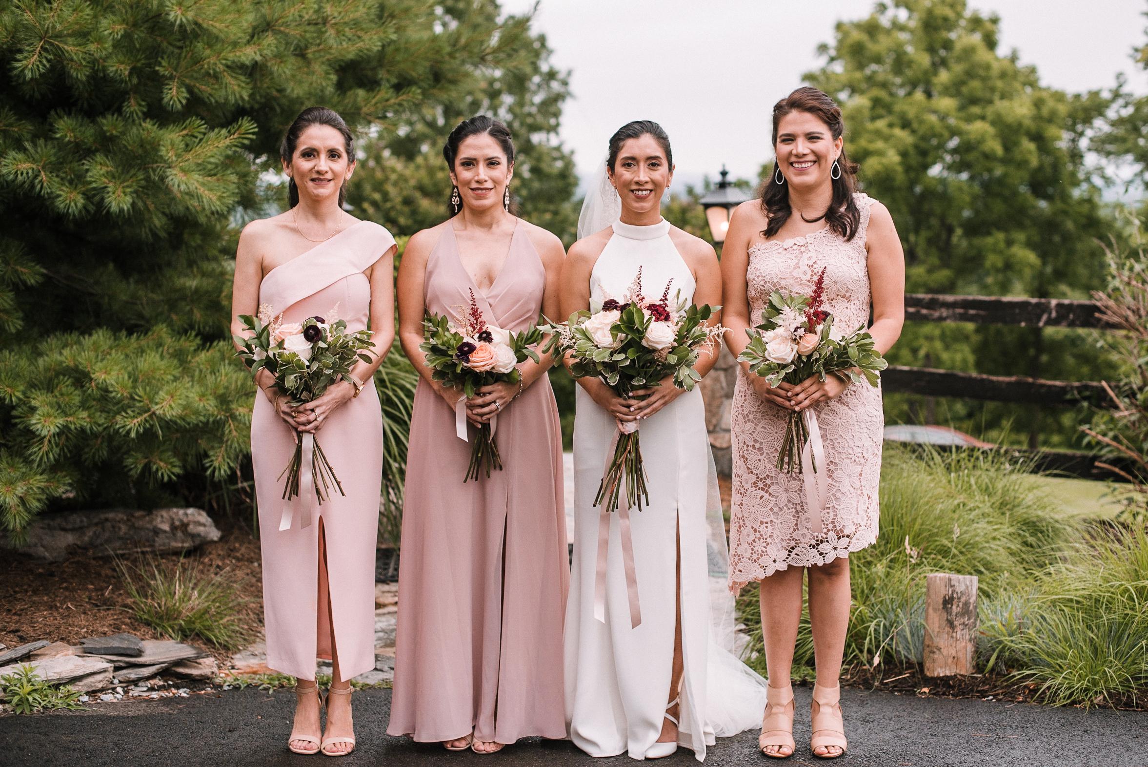 bride and bridesmaids smiling at Bluemont Vineyard