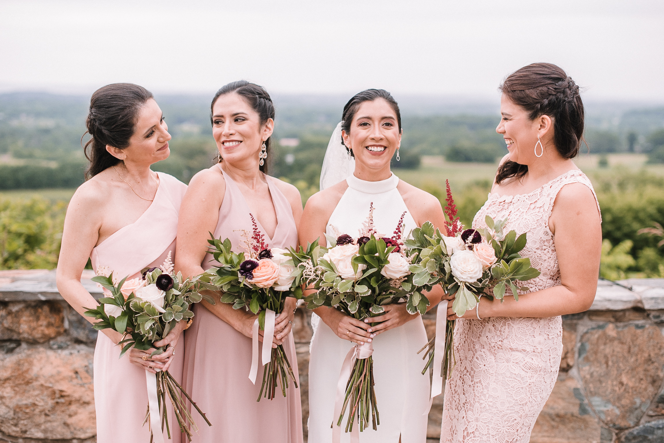 bride and bridesmaids laughing at Bluemont Vineyard