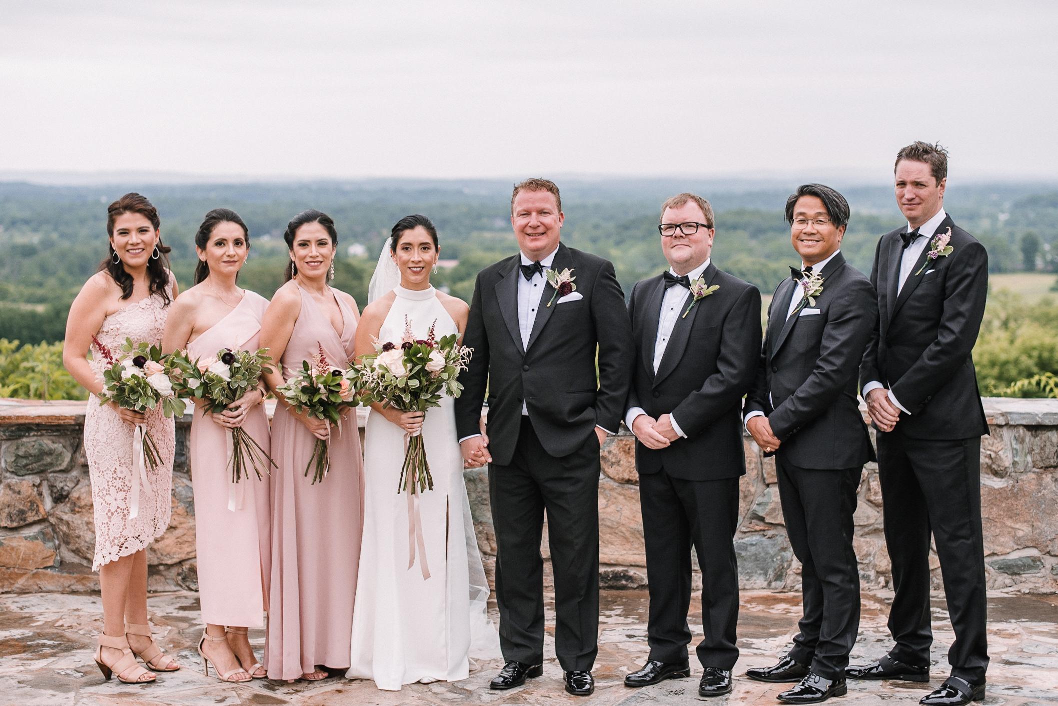 wedding party smiling at Bluemont Vineyard