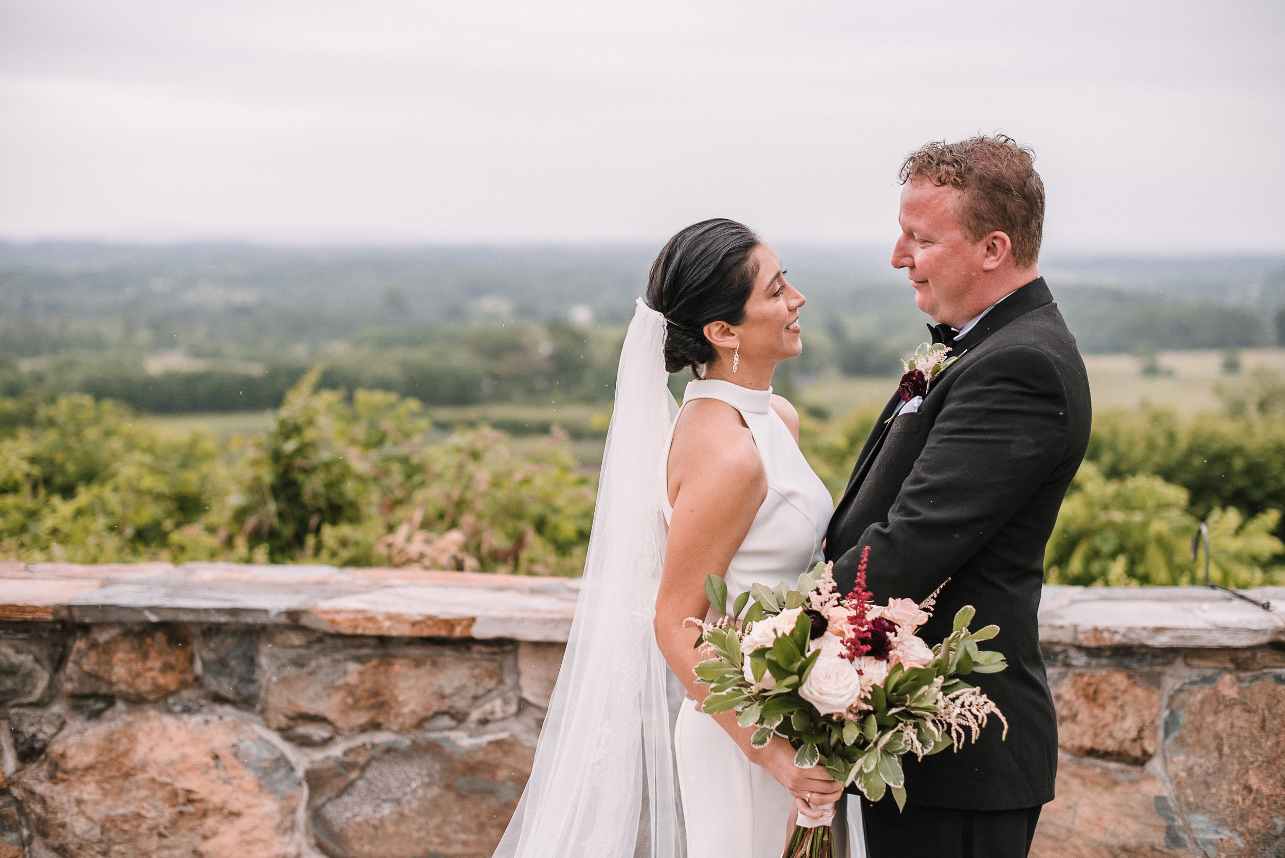 bride and groom smiling at each other at Bluemont Vineyard