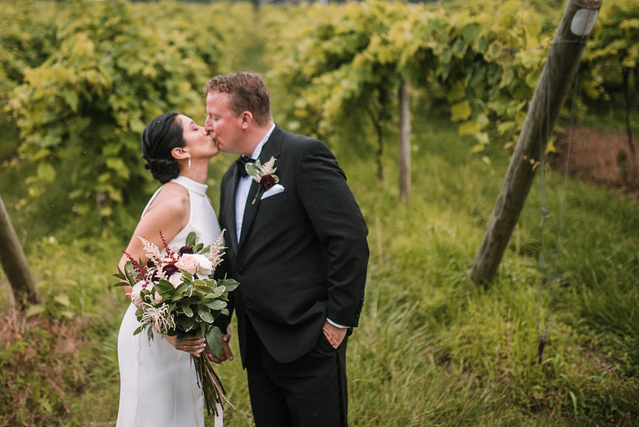 bride and groom kissing at Bluemont Vineyard