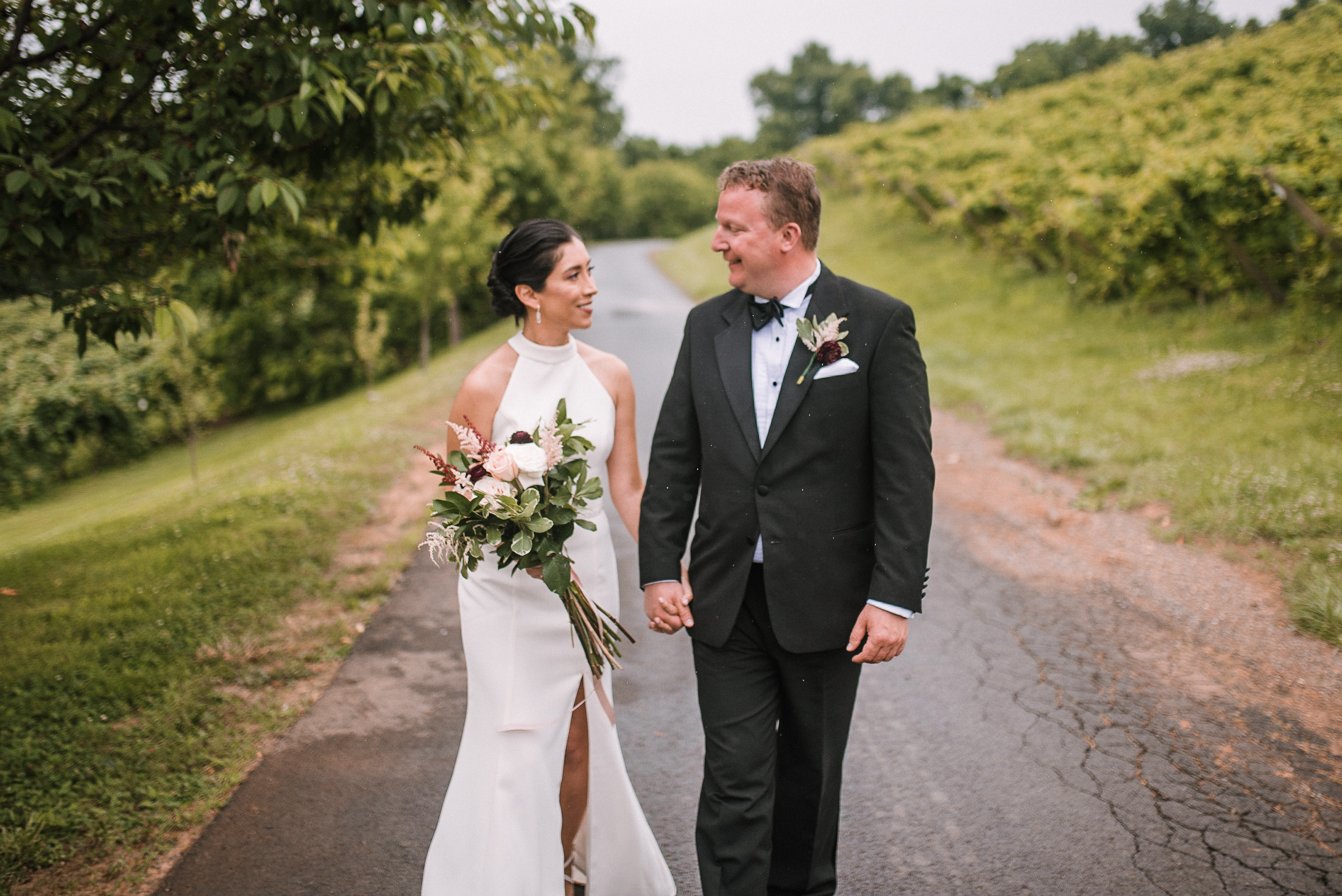 bride and groom holding hands at Bluemont Vineyard
