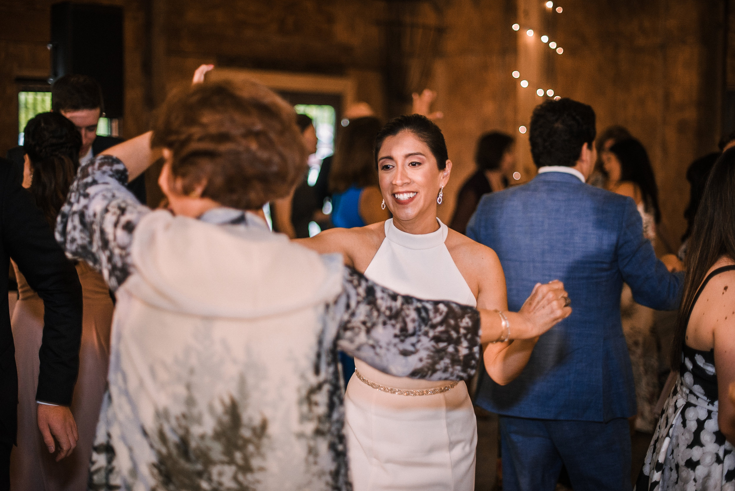 bride dancing with guest at reception at Bluemont Vineyard