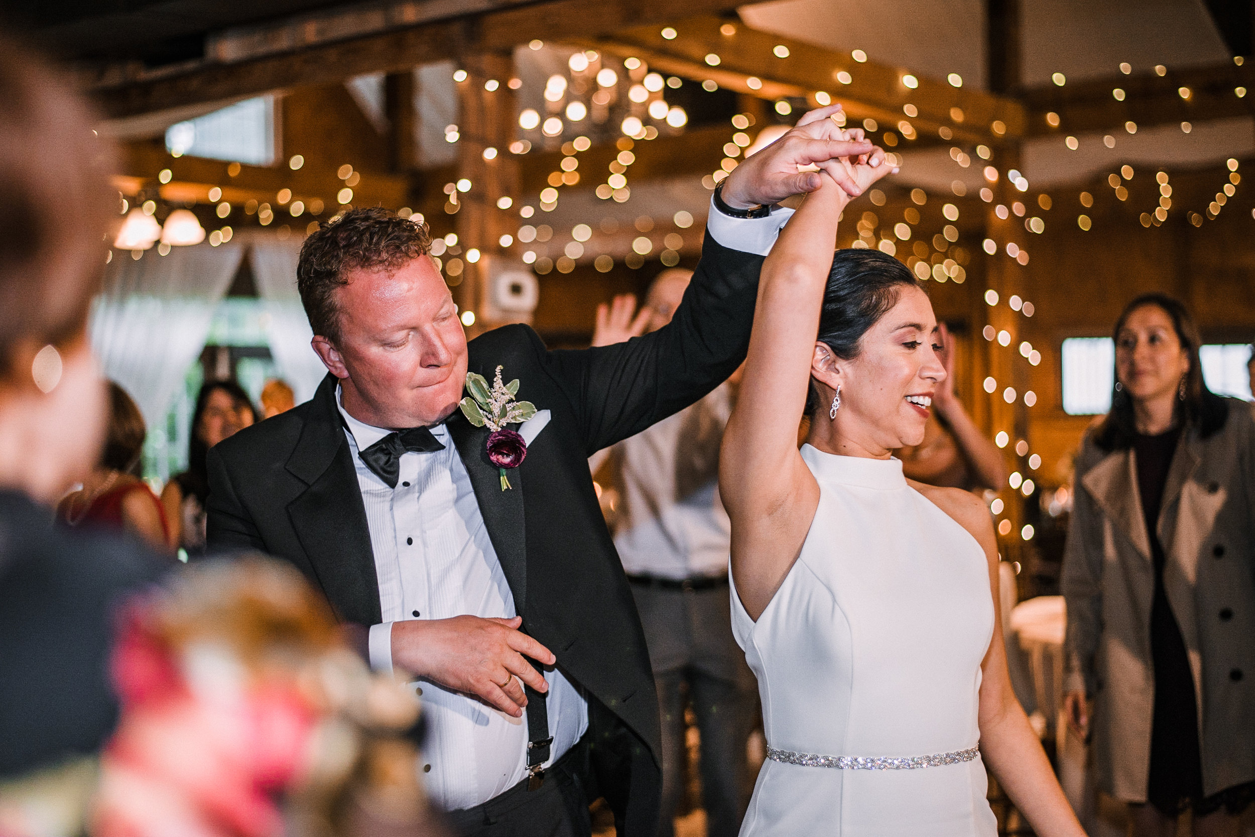 bride and groom dancing at reception at Bluemont Vineyard