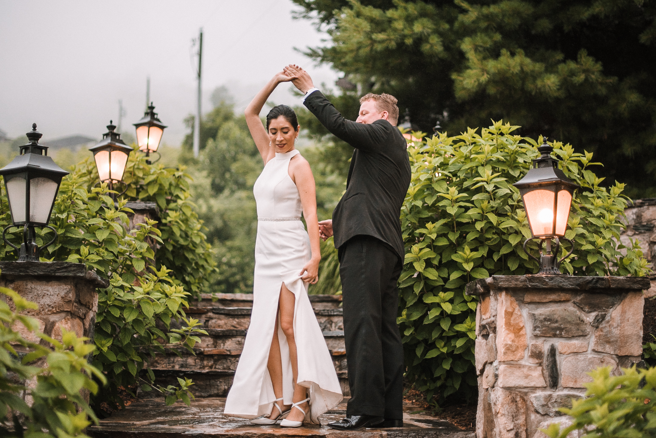 bride and groom twirling at Bluemont Vineyard