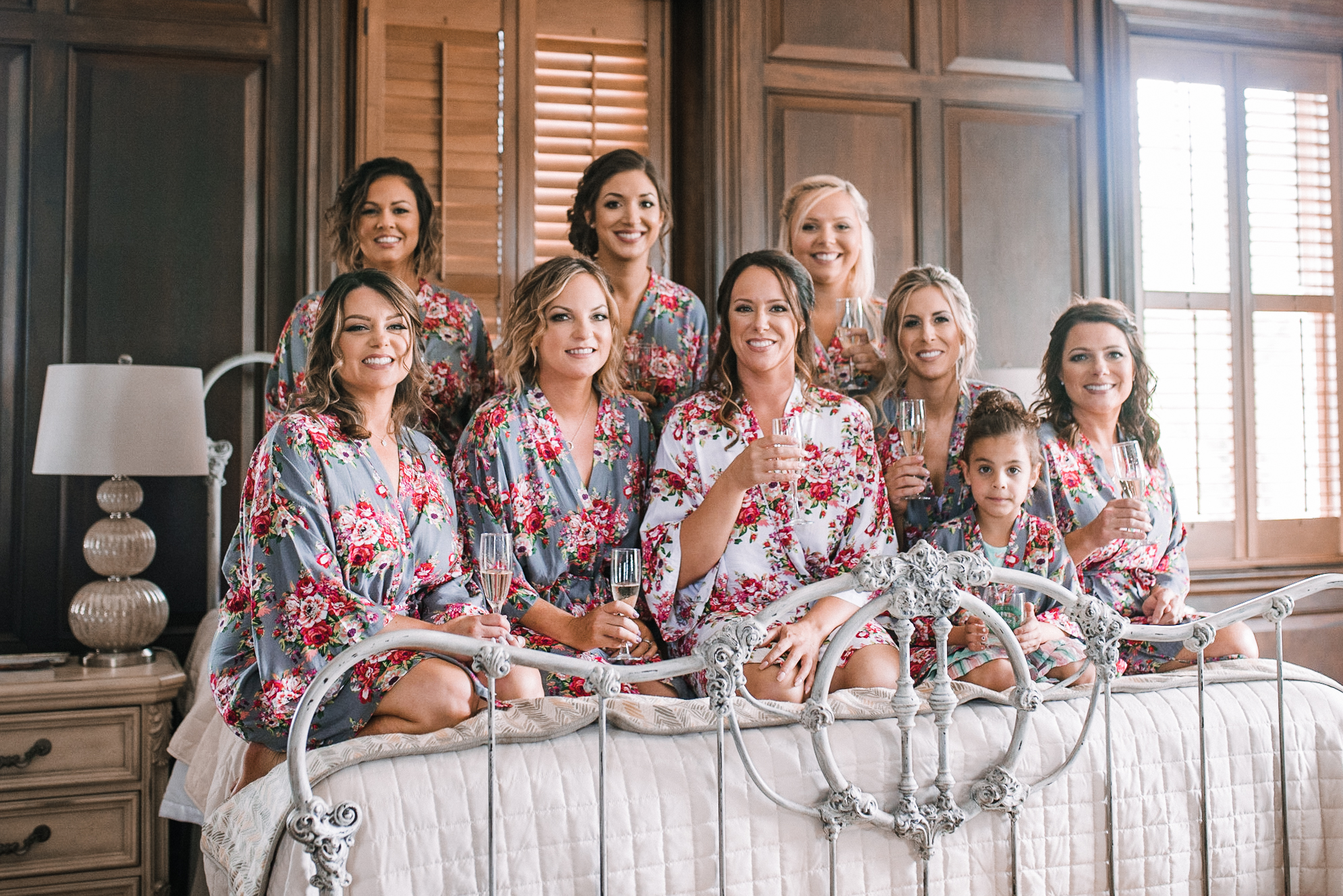 bride and bridesmaids posing at Evergreen Country Club