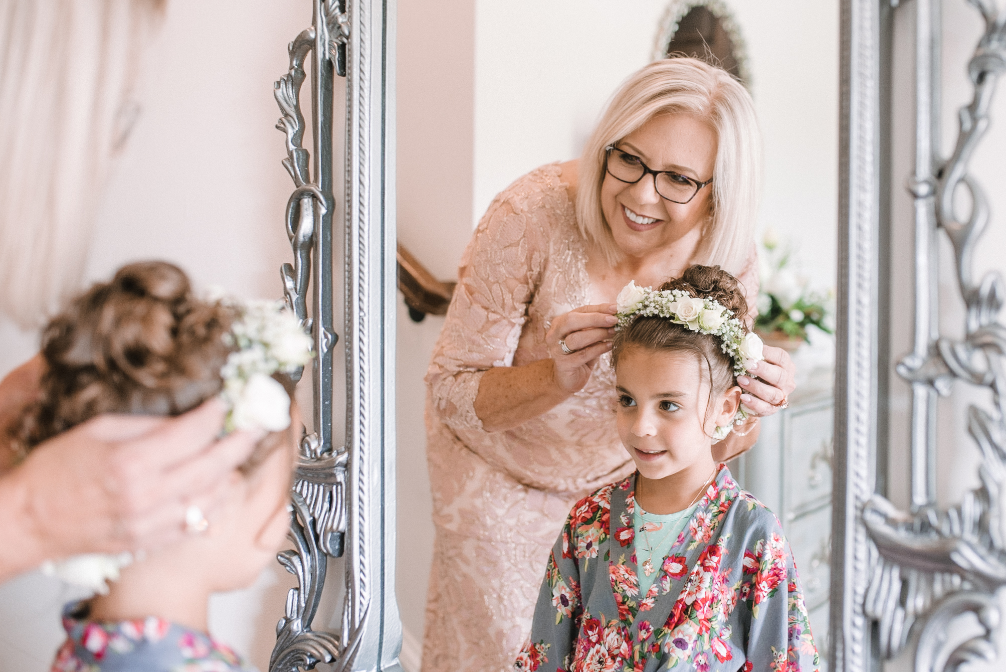 mother of the bride helping flower girl get ready at Evergreen Country Club