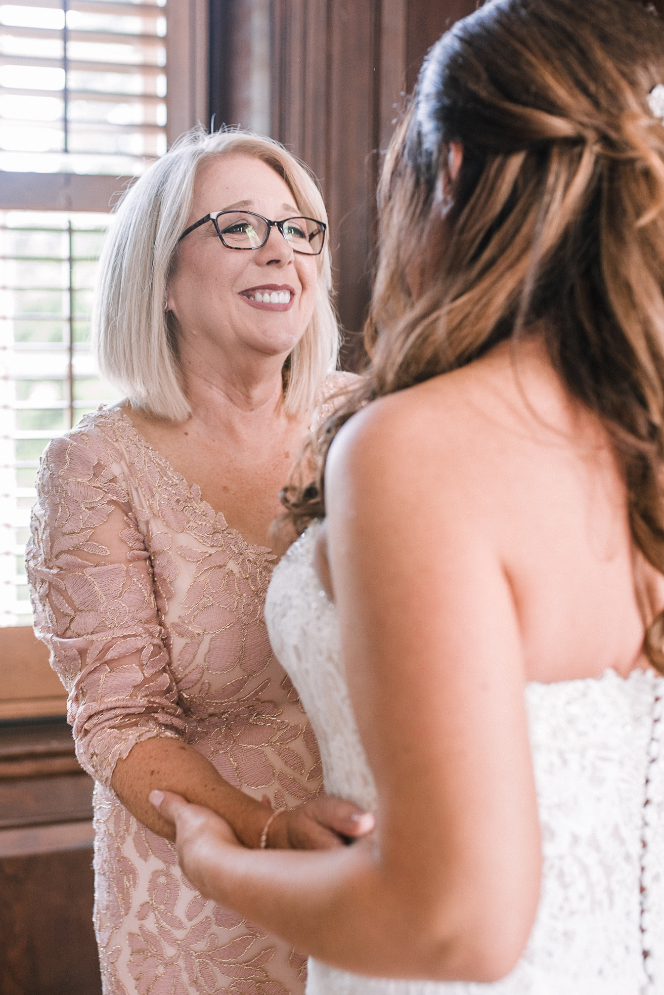 mother of the bride embracing bride at Evergreen Country Club