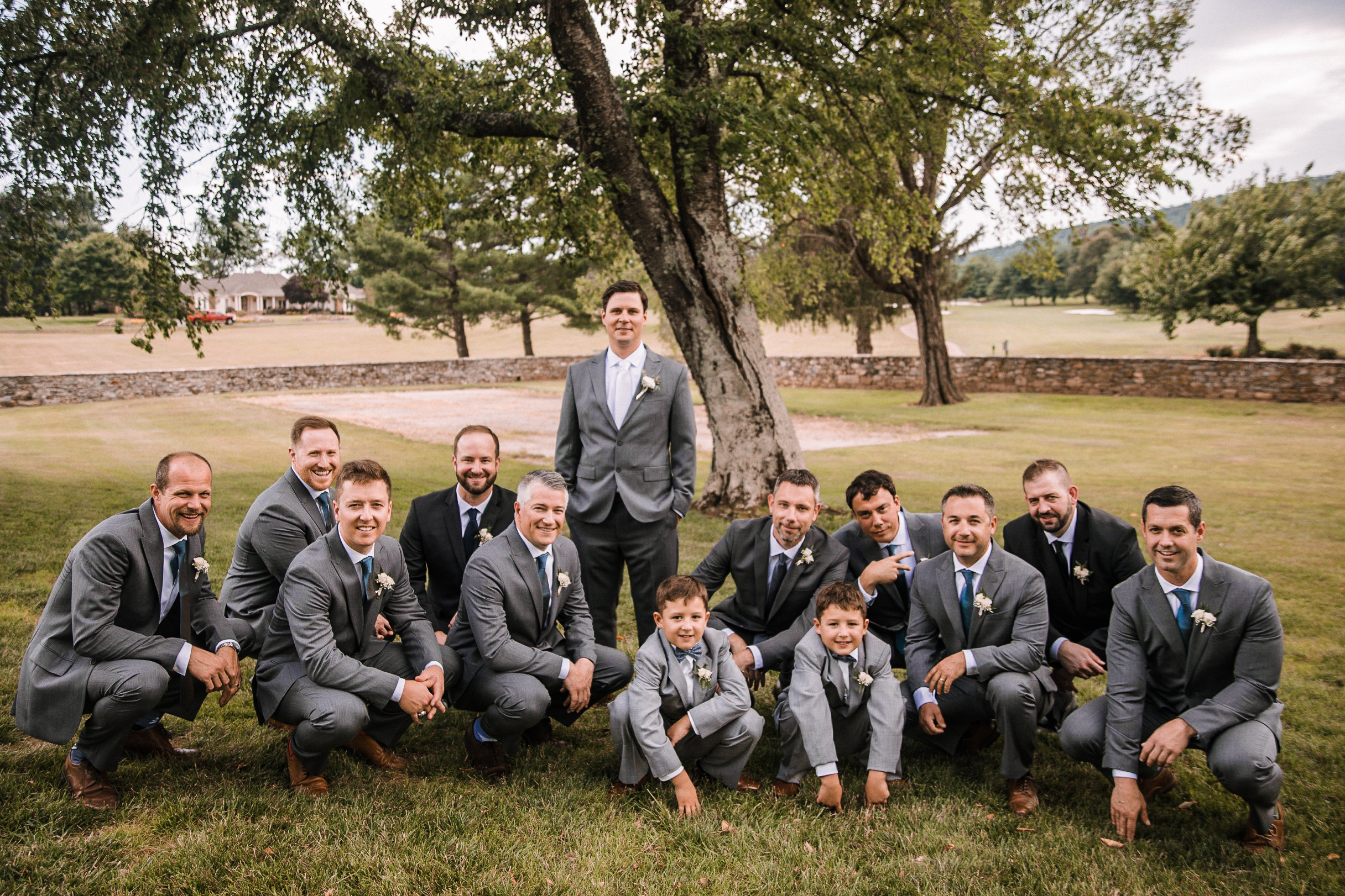 groom and groomsmen posing at Evergreen Country Club